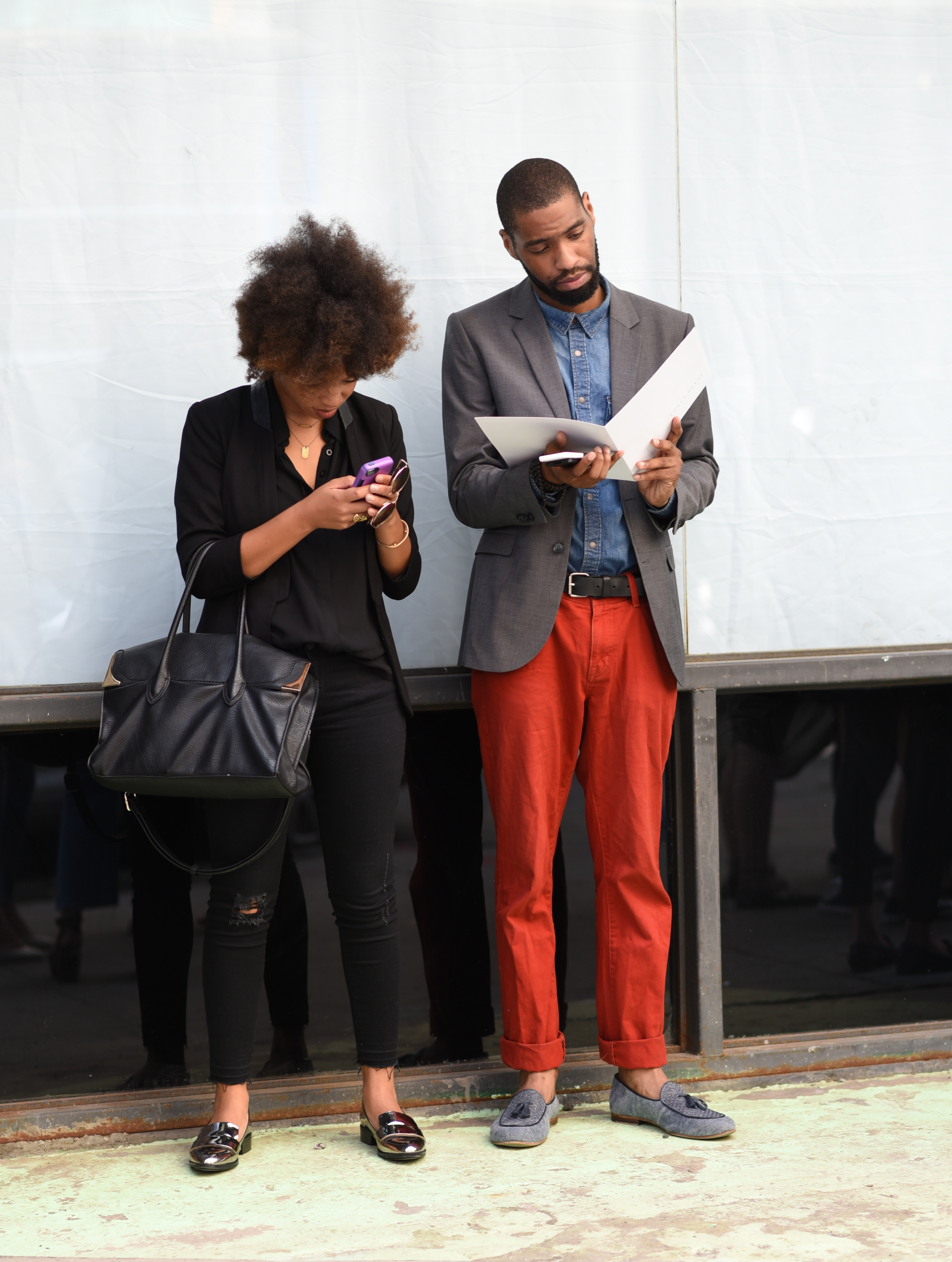 Almost every man at Fashion Week rolled their pants at the ankles. Red pants were popular with the men as well.