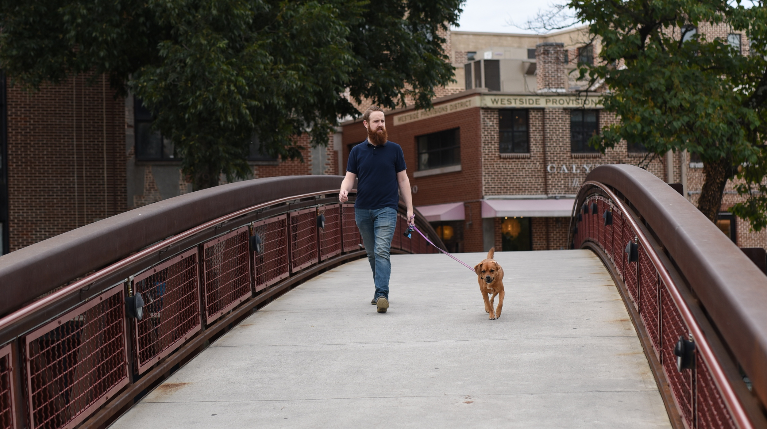 guy-walking-over-bridge.jpg