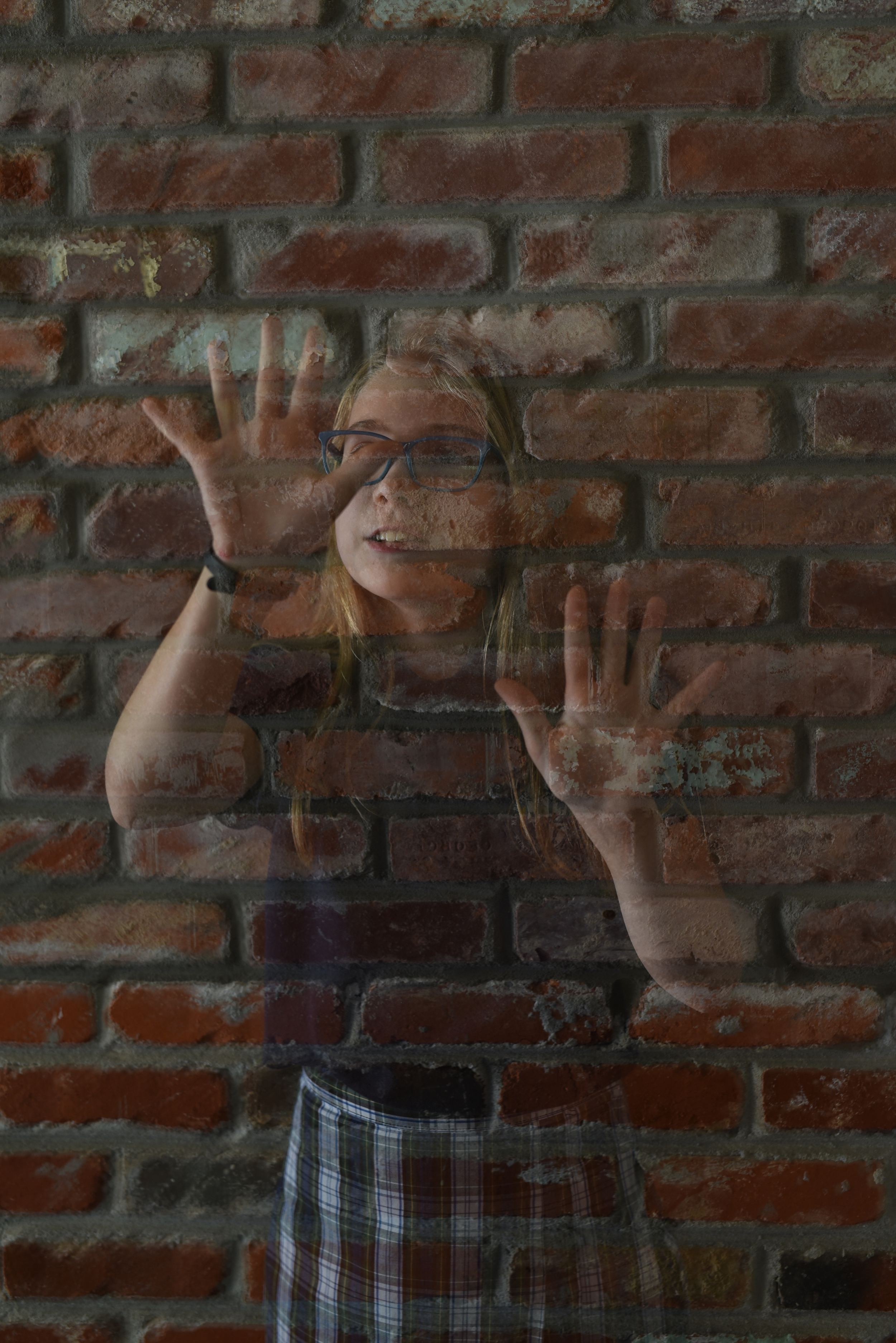 girl-stuck-in-bricks.jpg