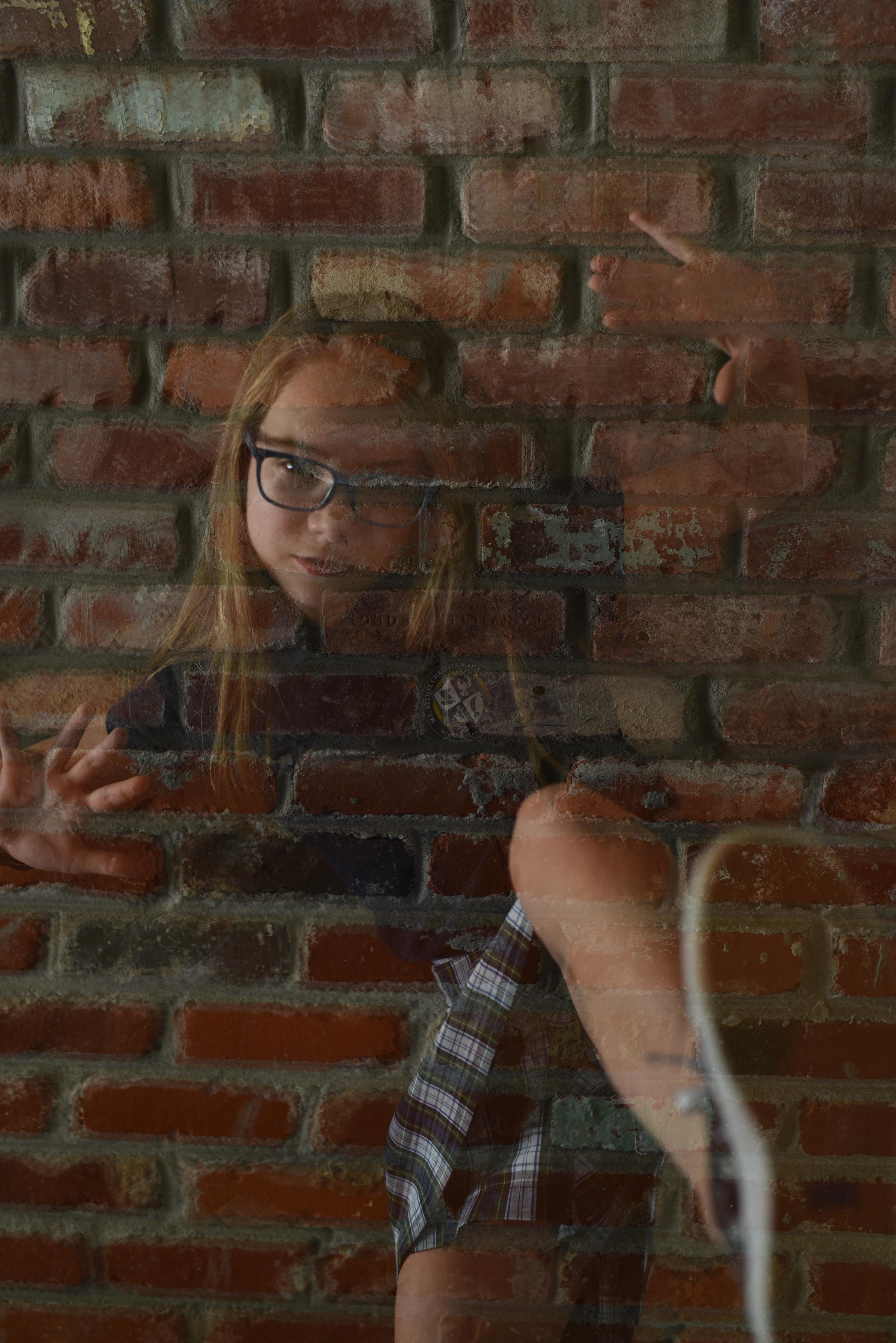 girl-breaking-out-of-bricks.jpg