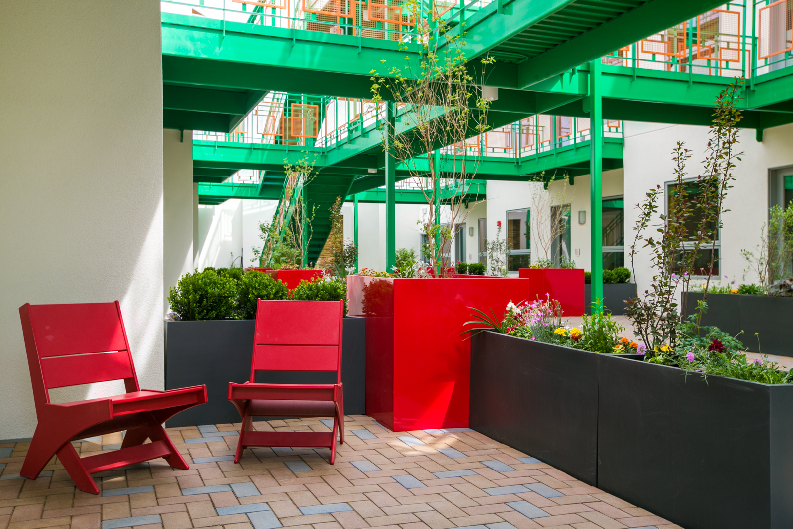Our patio level offers an outdoor garden at your doorstep. Each patio level home has its own limited common area patio for your own furniture and private space. The center corridor is outdoor space for all owners to enjoy the garden.