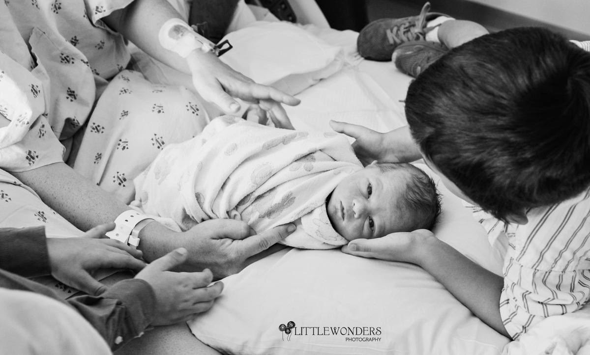 Beautiful-Labor-Photograph-Brothers-Holding-Baby
