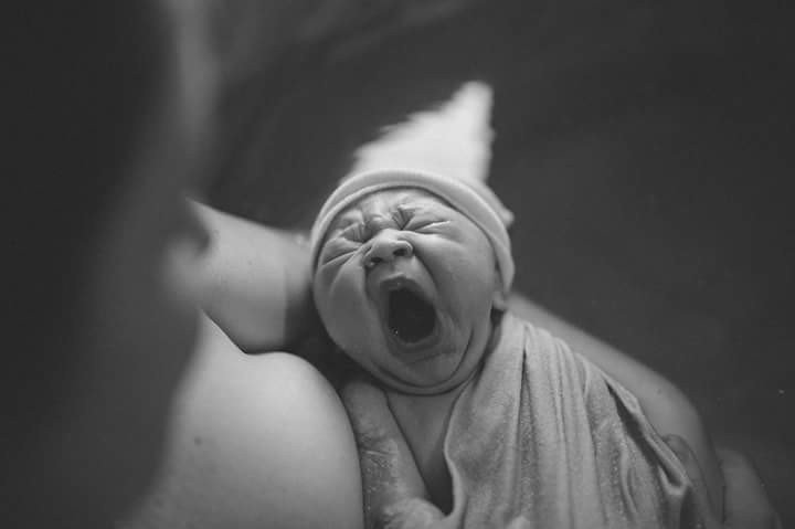 yawning-baby-birth-photo