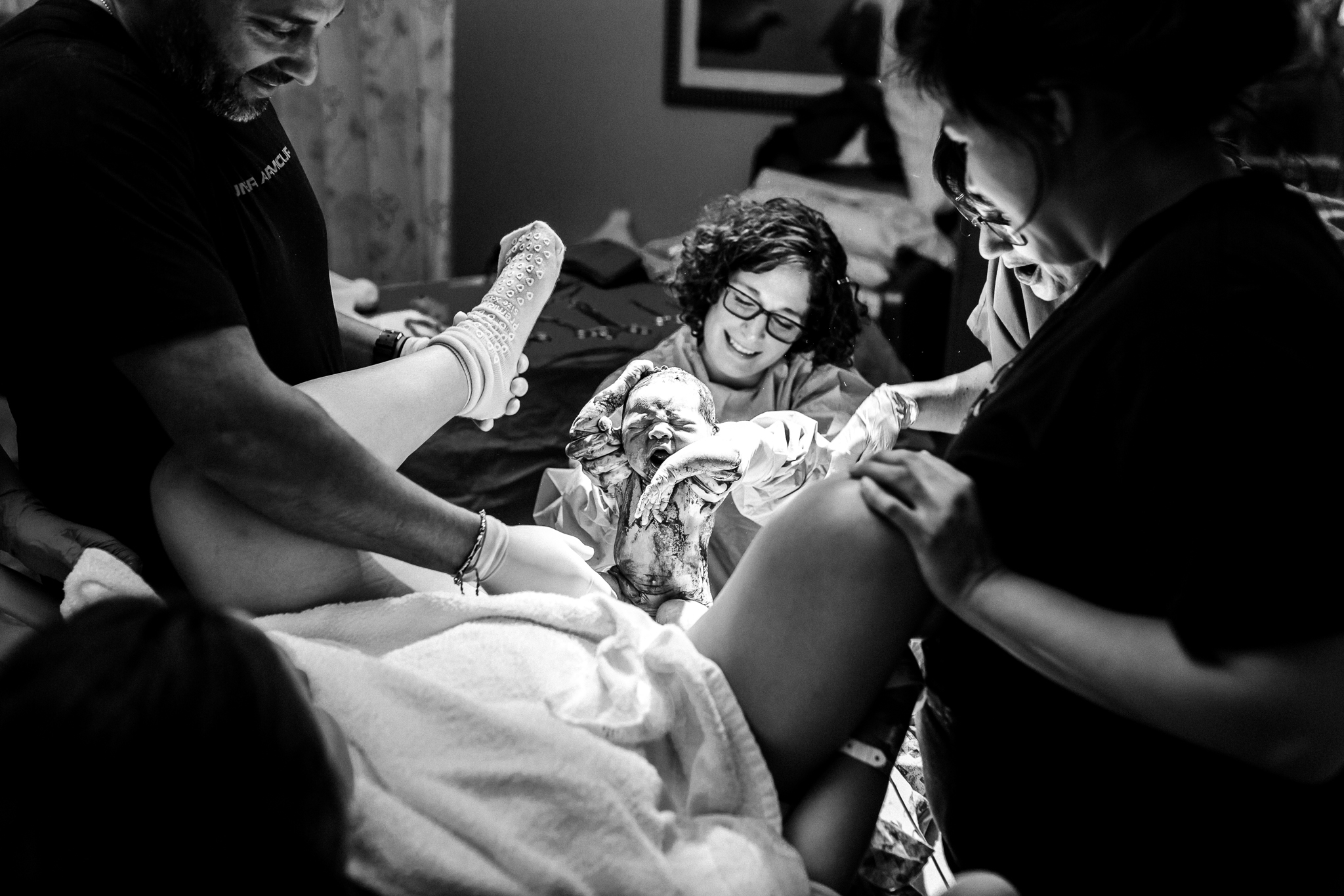"""""""Birth is so unpredictable, but the sweet sounds of a new crying baby always seem to bring a smile to everyone's face no matter what the struggles may have been.his first time mama tried so very hard to get her home water birth. After her transfer, she patiently waited to meet her sweet baby girl. That moment finally arrives and the entire room lit up with joy at the sight of this baby girl finally being earth side""""   Norma Hess Photography"""