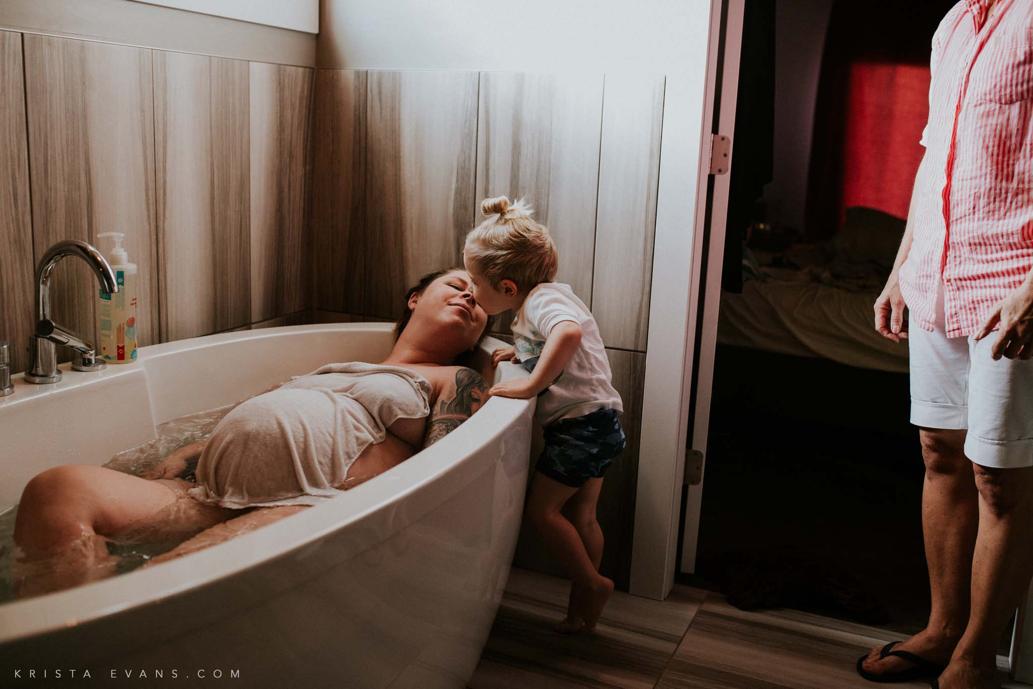 In the throes of active labor, this kiss is all that she needs to calm her breath and fill her heart.   Love by Krista Evans Photography