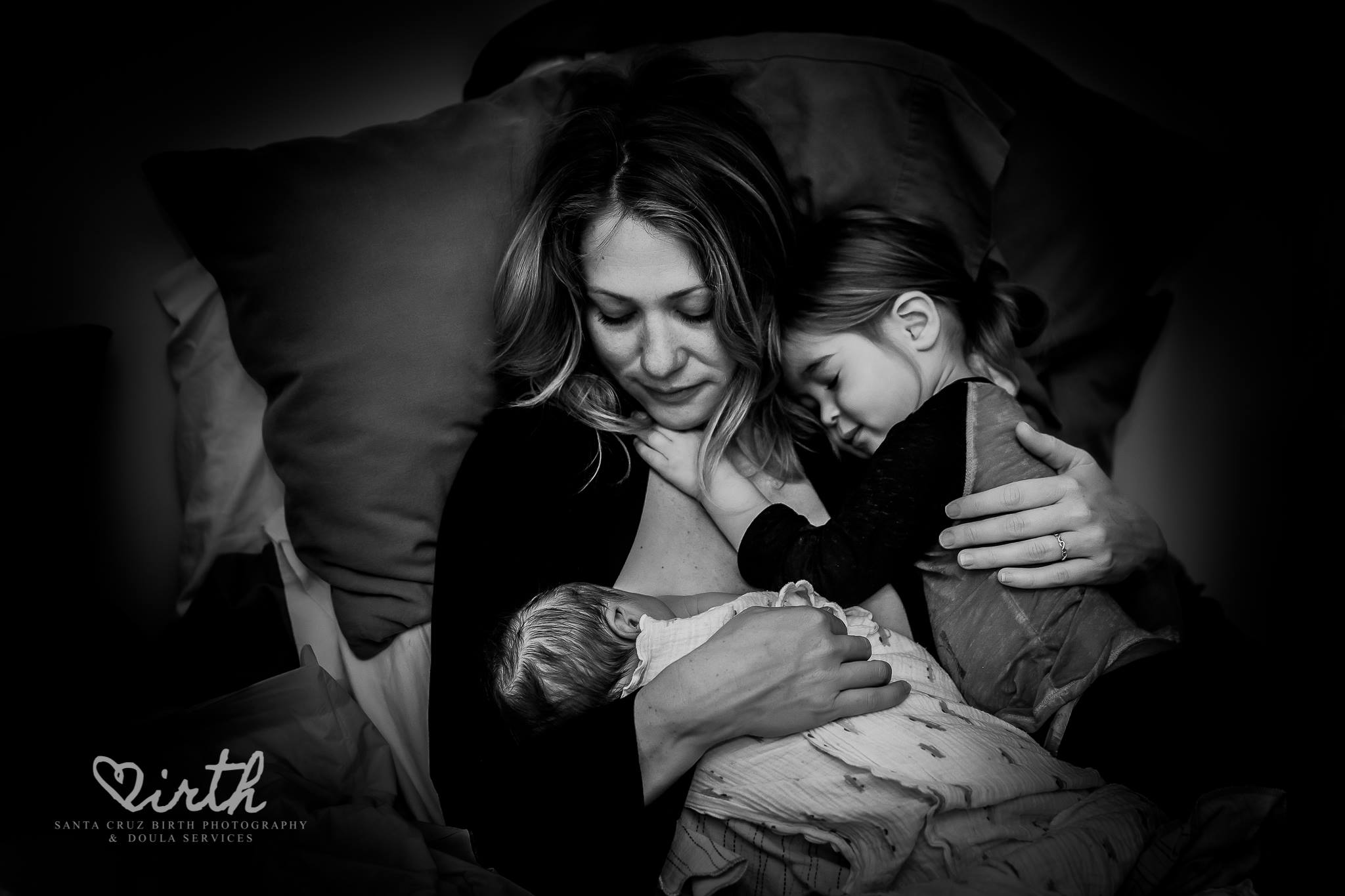 A tender moment by  Santa Cruz Birth Photography and Doula Services