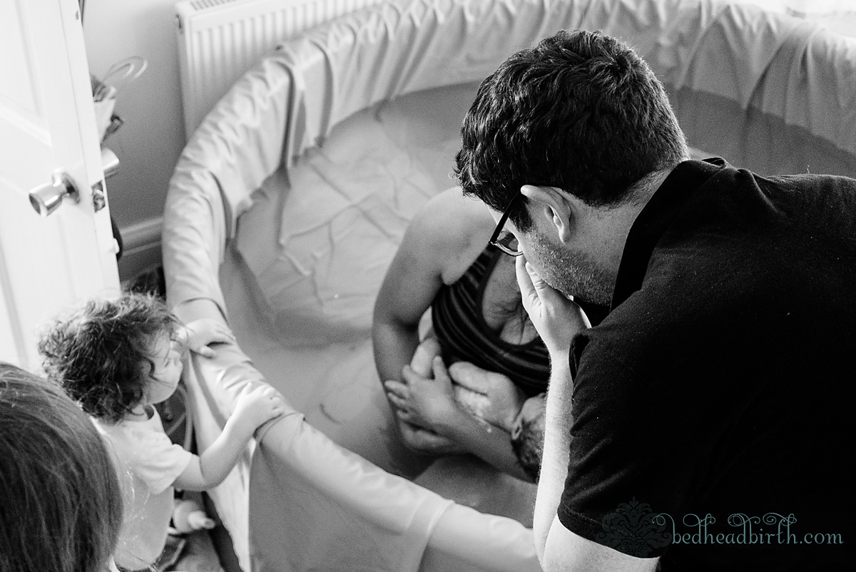 baby in arms, water birth, home, england