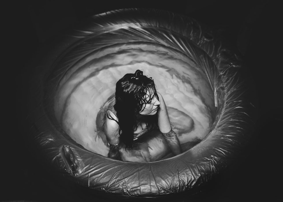 """""""In the Eye of the Storm"""" - by  Katie Lewis  This title is really captivating; not only is she in the midst of the 'contraction storm', but she looks like she's in the eye of a storm visually. It draws you in, with just the title and a glance at the image!"""