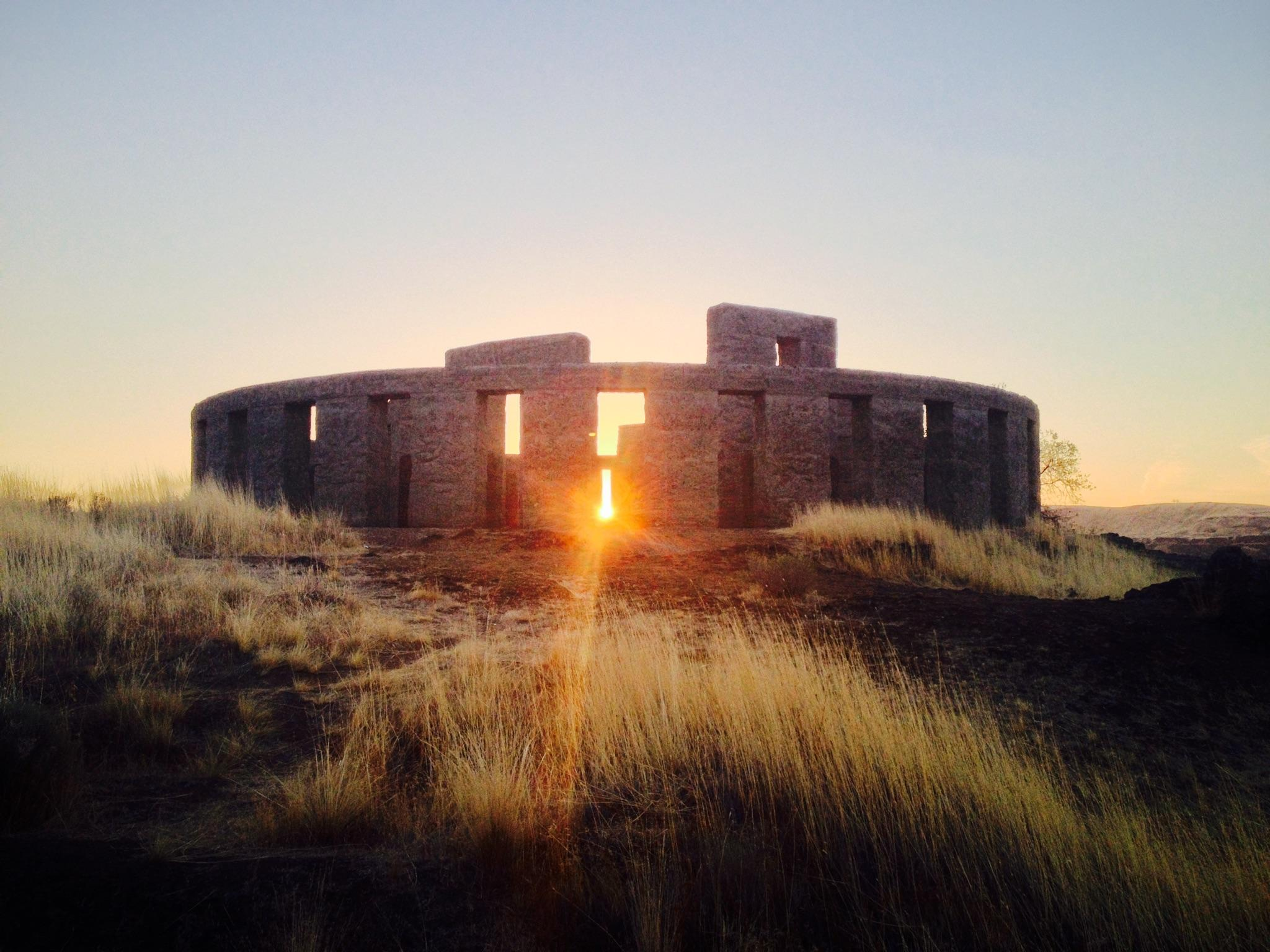 This photo was takenon the fall equinox at Stonehenge. No, not that one. This one is in Maryhill, Washington. The Stonehenge may not be the real thing, but the sunrisedefinitely is.
