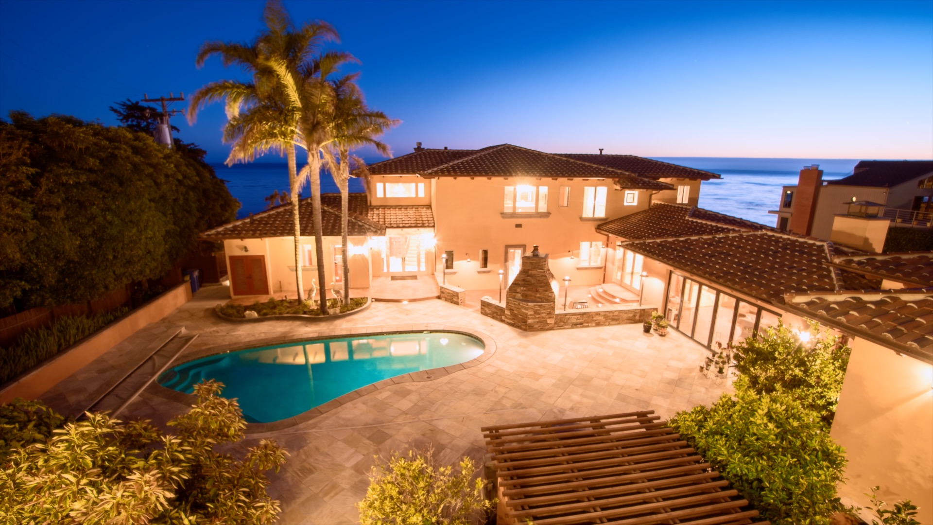 The sun sets on the Pacific Ocean behind this beautiful home in Pismo Beach, CA.