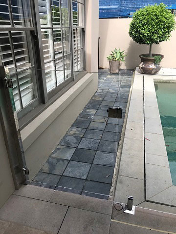 Glass door with glass pool fence.jpg