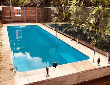 Frameless Glass pool fence around square pool