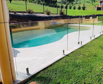 Frameless glass pool fence around special shape pool