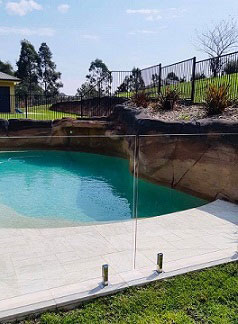Frameless glass pool with aluminium pool fencing