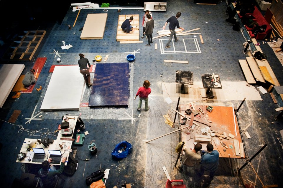 Volunteers build the new stage. Image Credit: Claudio Apicella