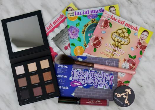 The contents of the June 'Downtown Charm' Boxycharm.