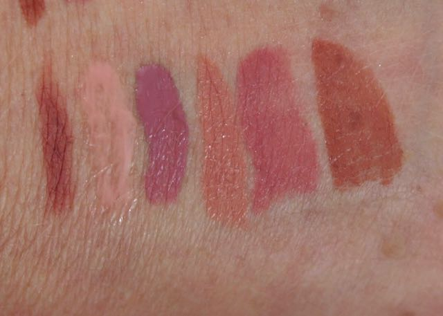 Swatches of the first Sephora Favorites - GIve Me Some Nude Lip - Estee Edit-In The Buff, Buxom-White Russian, Too Faced-Queen B, Bite Beauty-Honeycomb, Marc Jacobs-Slow Burn, and Urban Decay-1993.