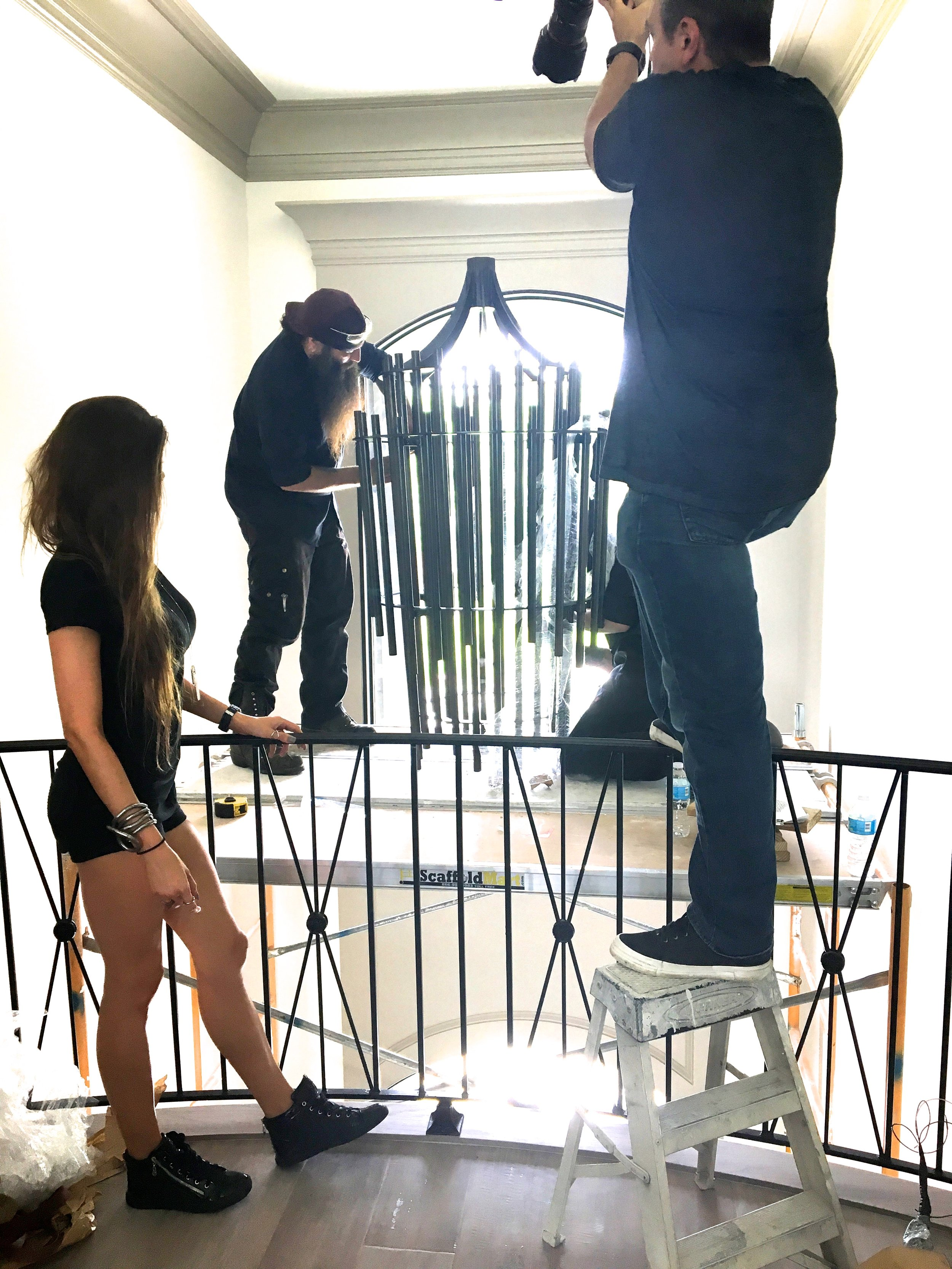 Behind the scenes photo of the 9 hour chandelier install!