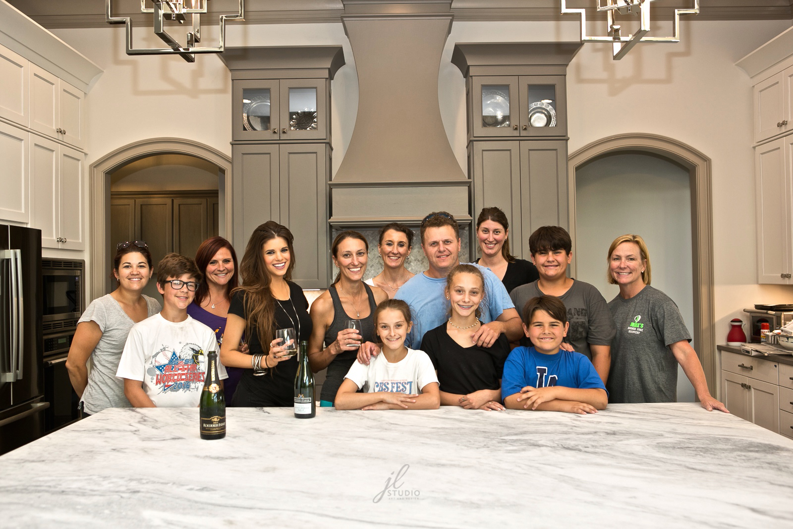 Friends and family toast to a successful move into their brand new home!
