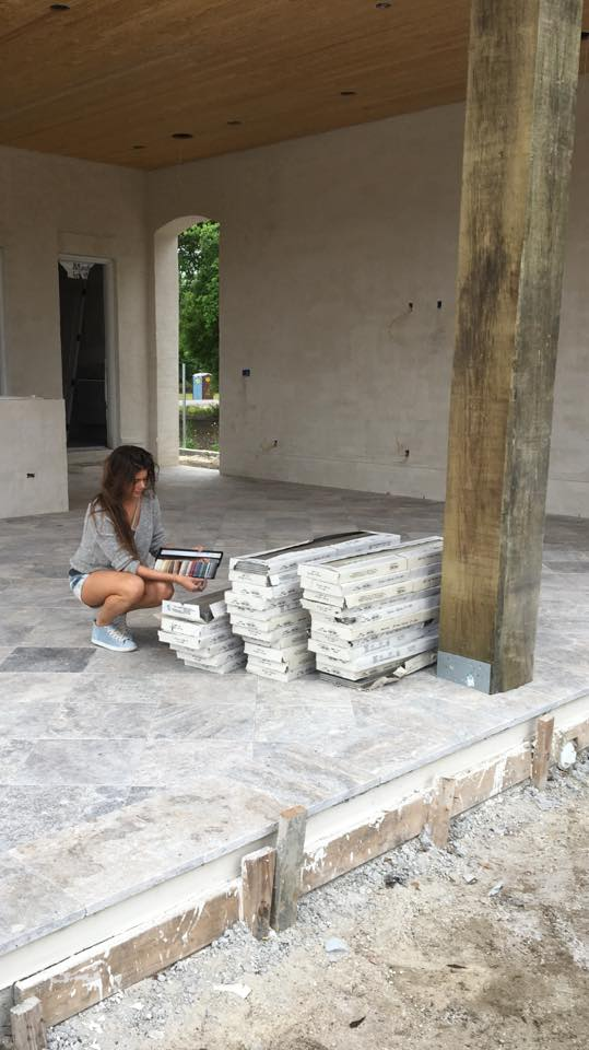 Jacquelyn Lindsey, Owner/Designer of JL Studio selecting grout colors for the new construction backyard