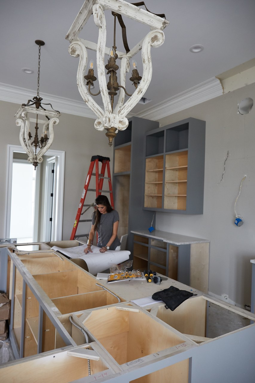 Designer Jacquelyn Lindsey verifying the cabinets are correct at install
