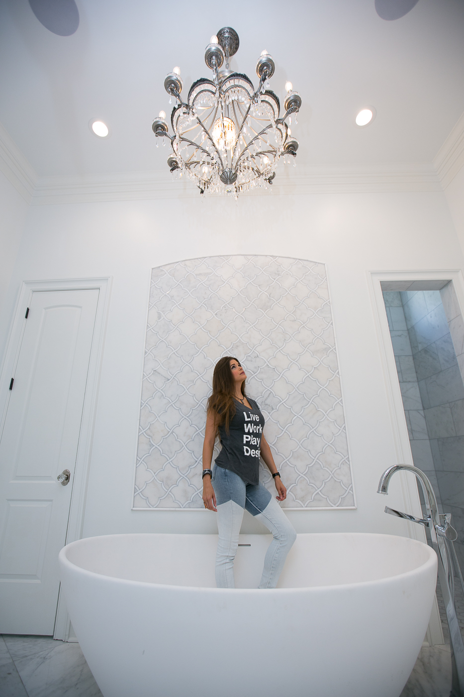 Designer Jacquelyn Lindsey in finished master bathroom design