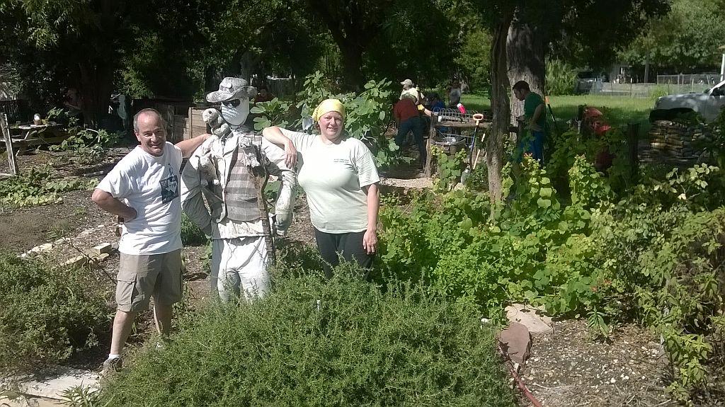 Larry Clark and Angela Hartsell, with resident garden volunteer