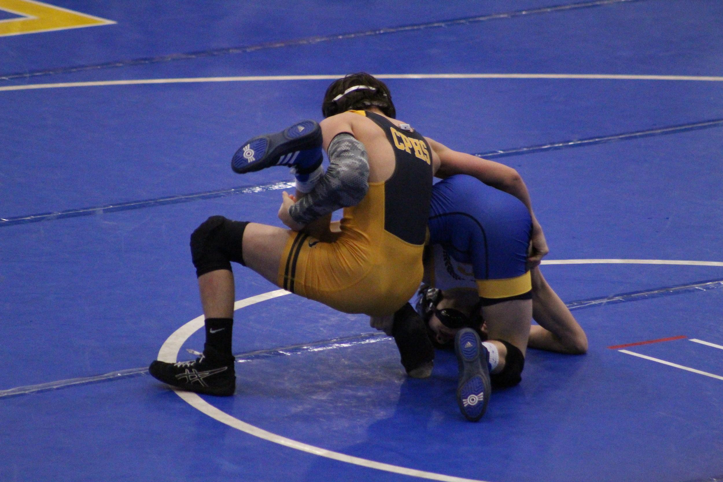 Sandite freshman Riley Weir puts up a fight against Choctaw's Colt Newton