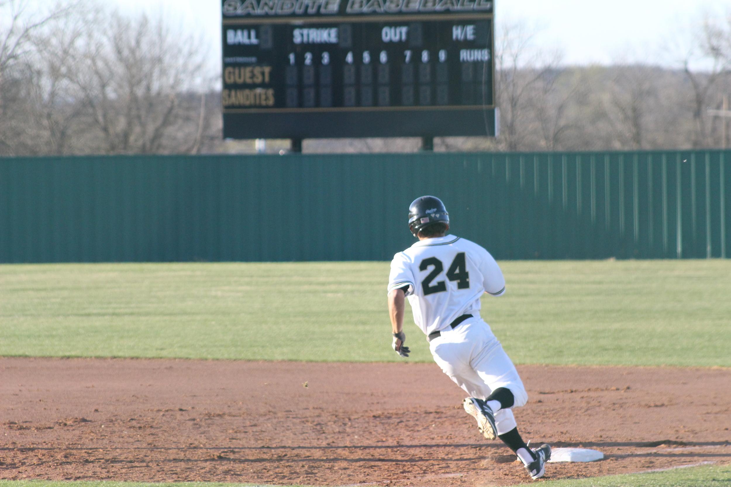 Rhett Rutledge rounds first base.
