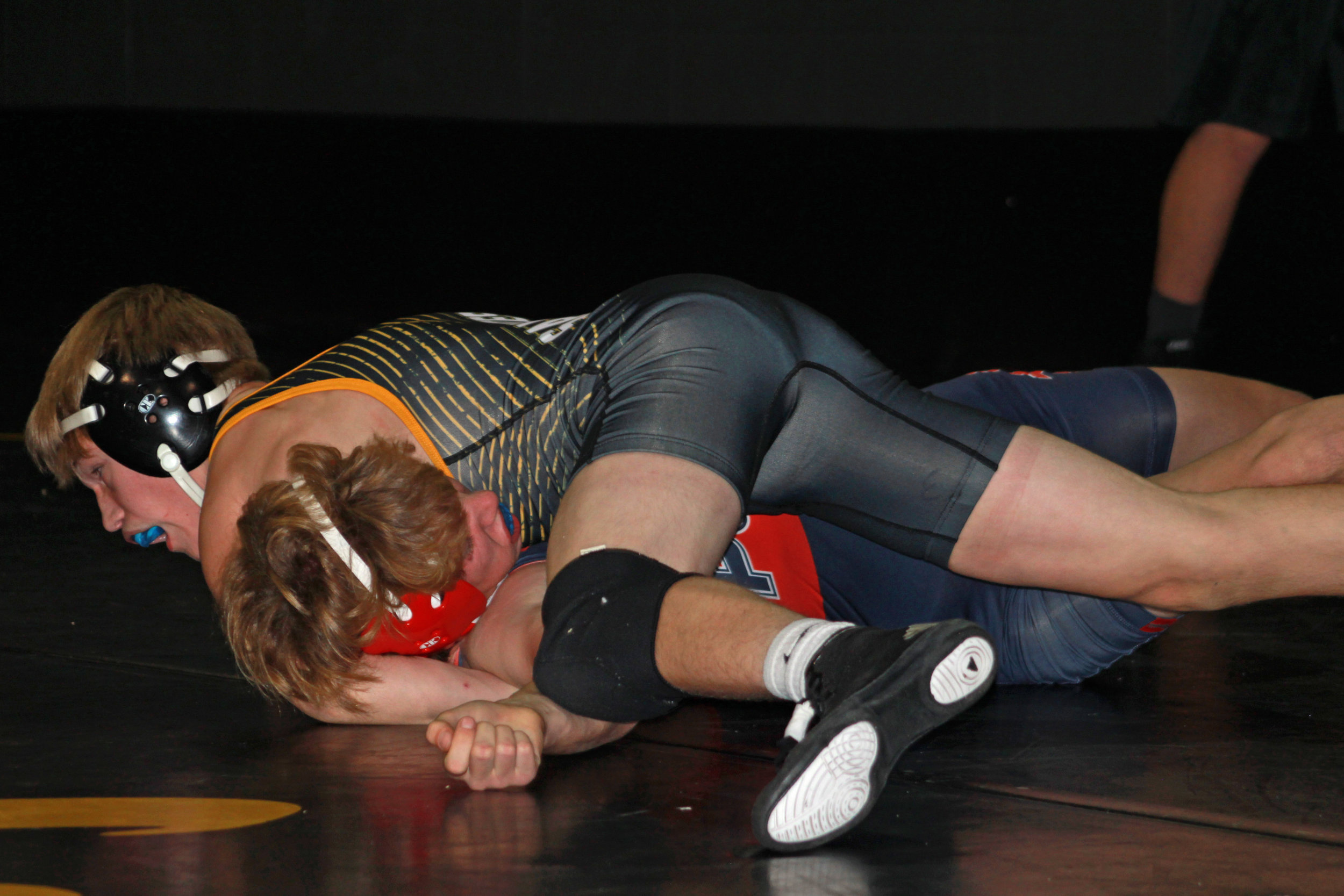 Freshman Caleb Phillips works on his fourth pin of the tournament. Photo: Scott Emigh