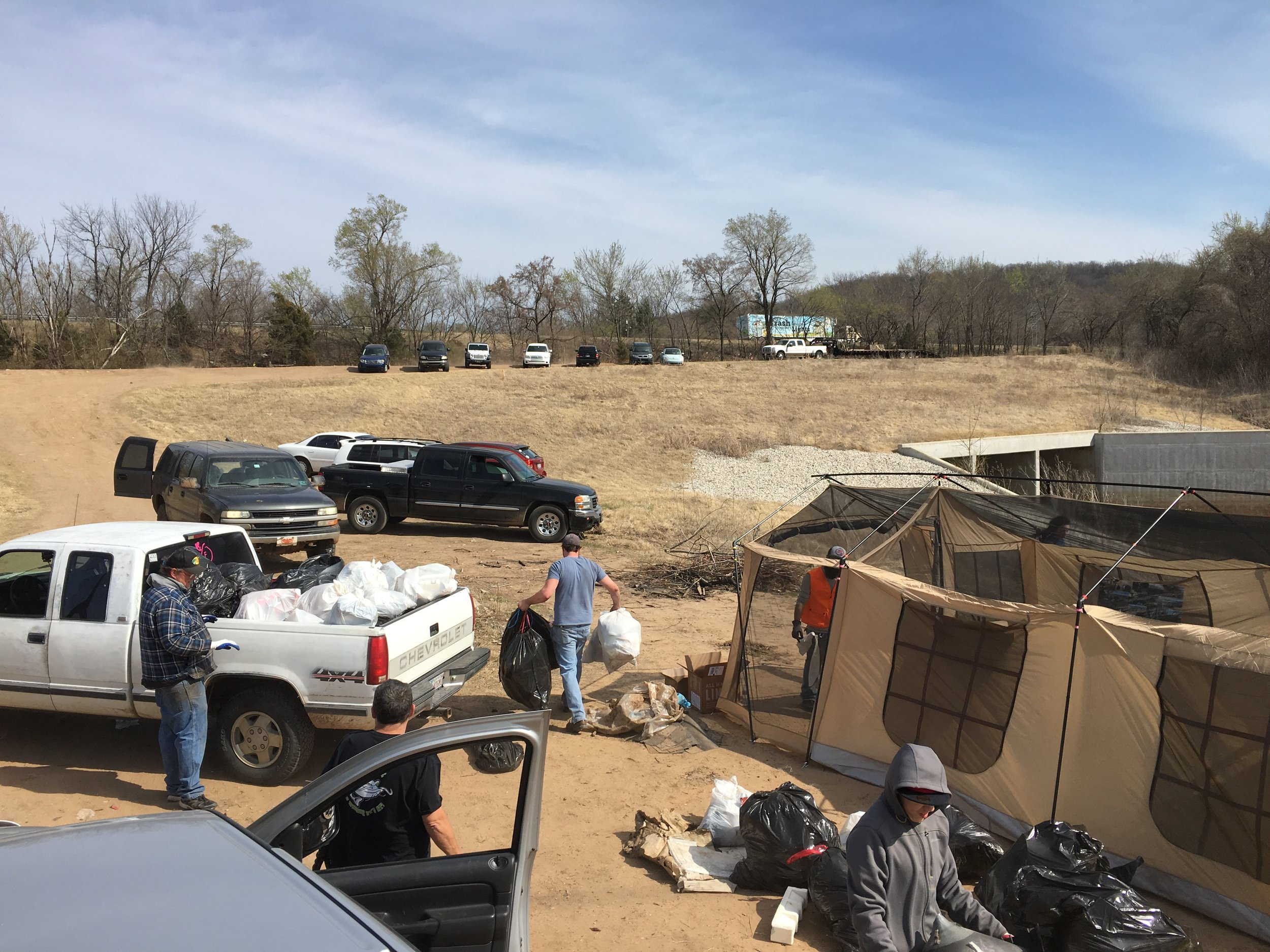 More than fifty individuals came together this past weekend in Sand Springs to help with a massive cleanup effort in a now-defunct Tulsa County Park. (SUBMITTED).