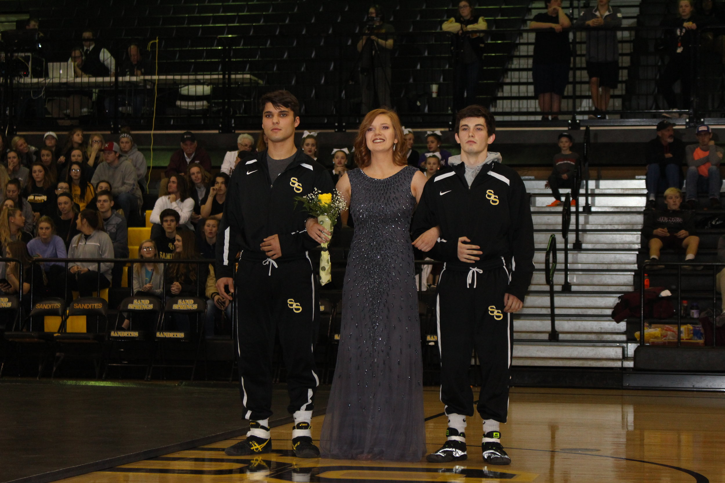 Homecoming Queen Candidate Katie Godown, escorted by Zane Basma and Tanner Ward.