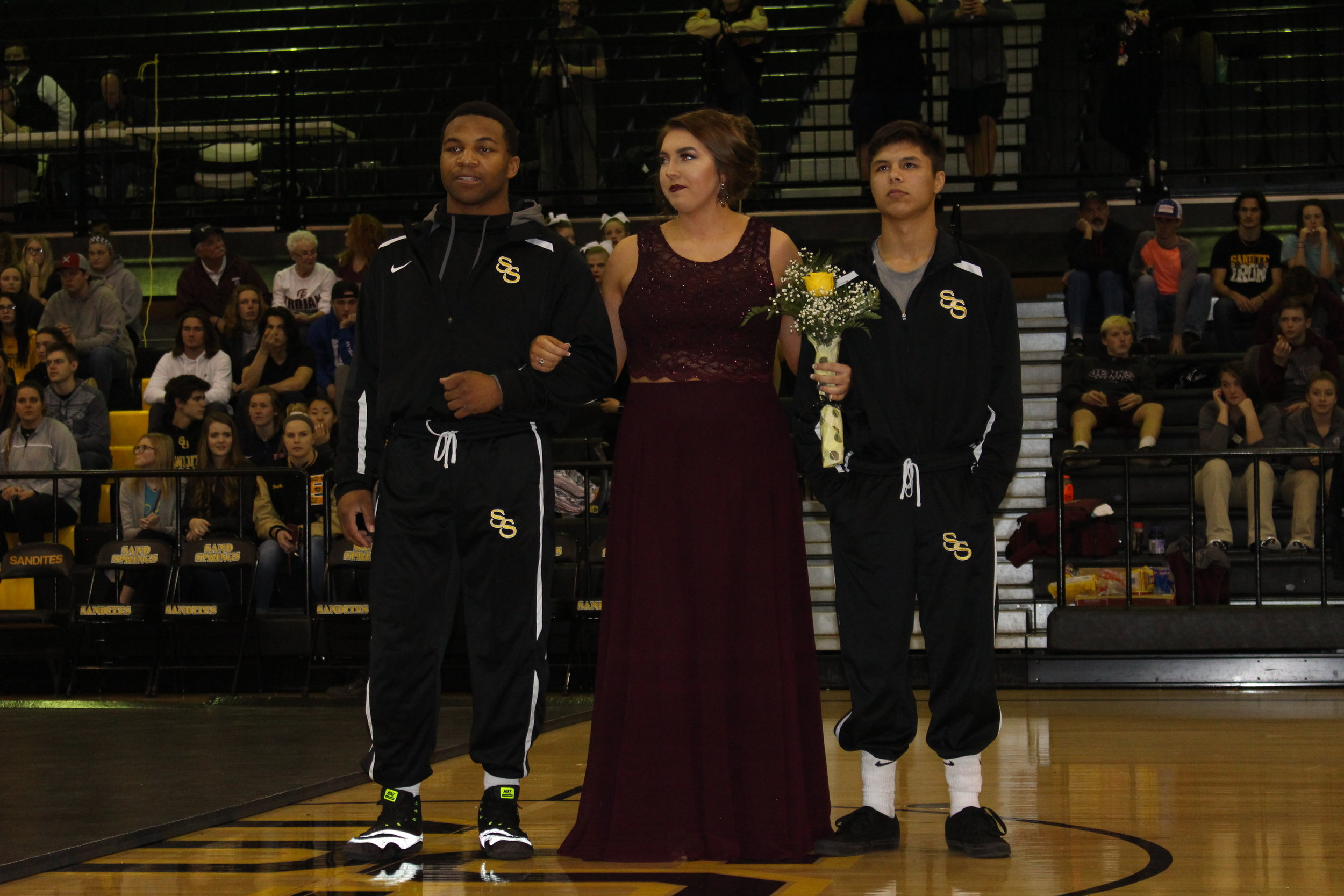 Homecoming Queen Candidate Anna Andrews, escorted by Delvin Jordan and Cody Mathis.