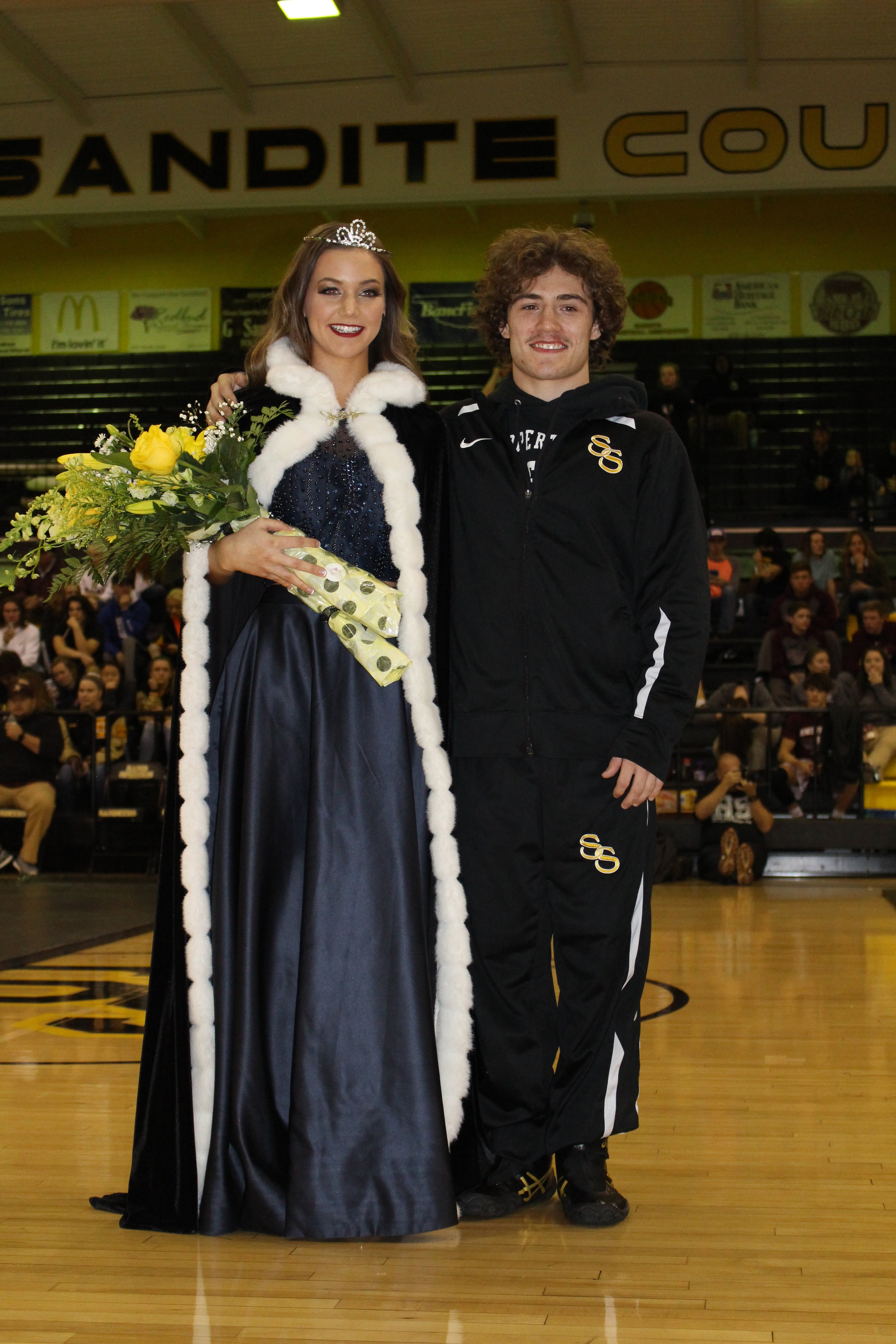 Homecoming Queen Sarah Noble with Kissing Captain Daton Fix.