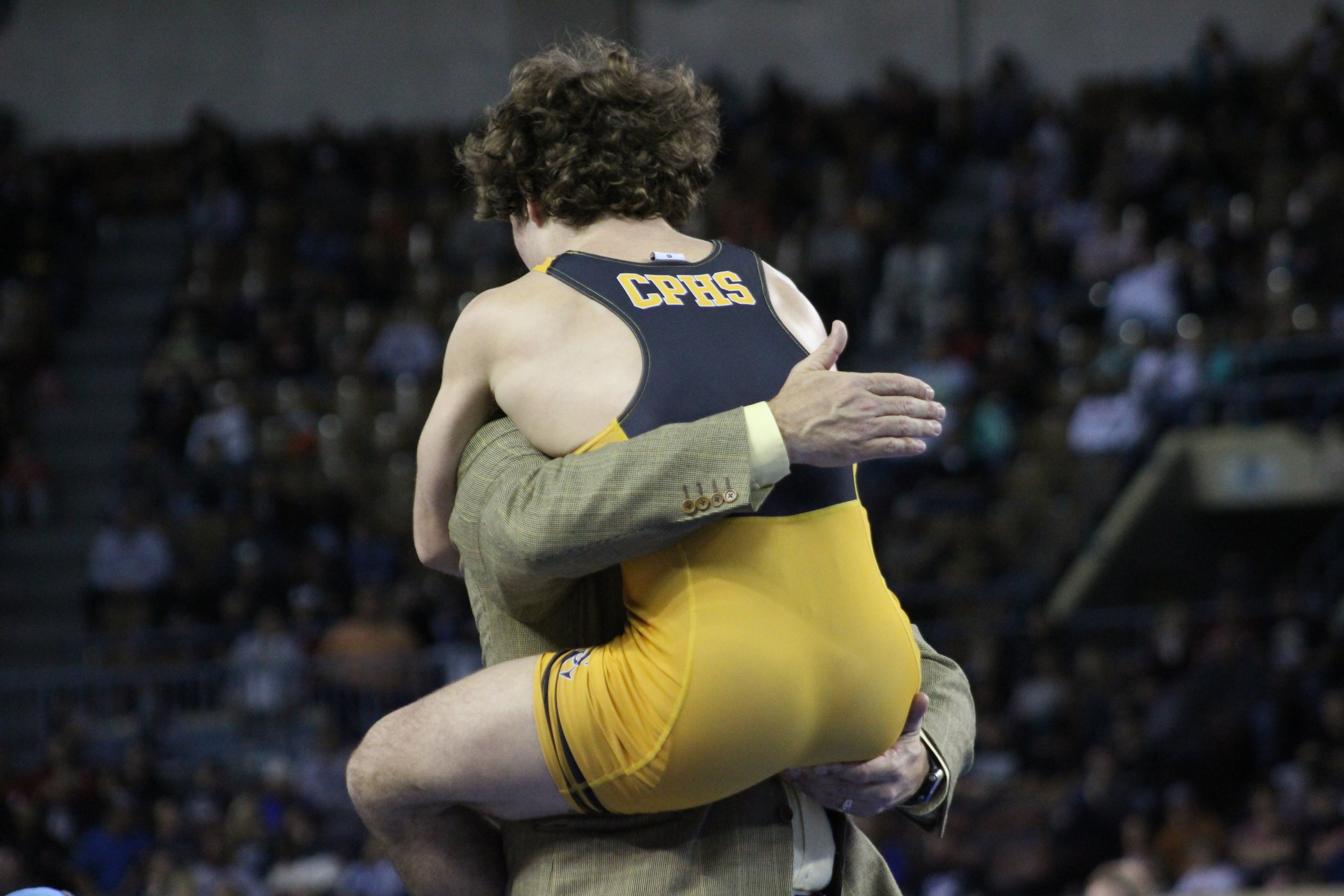 Daton Fix leaped into his father's arms after winning his fourth State title.