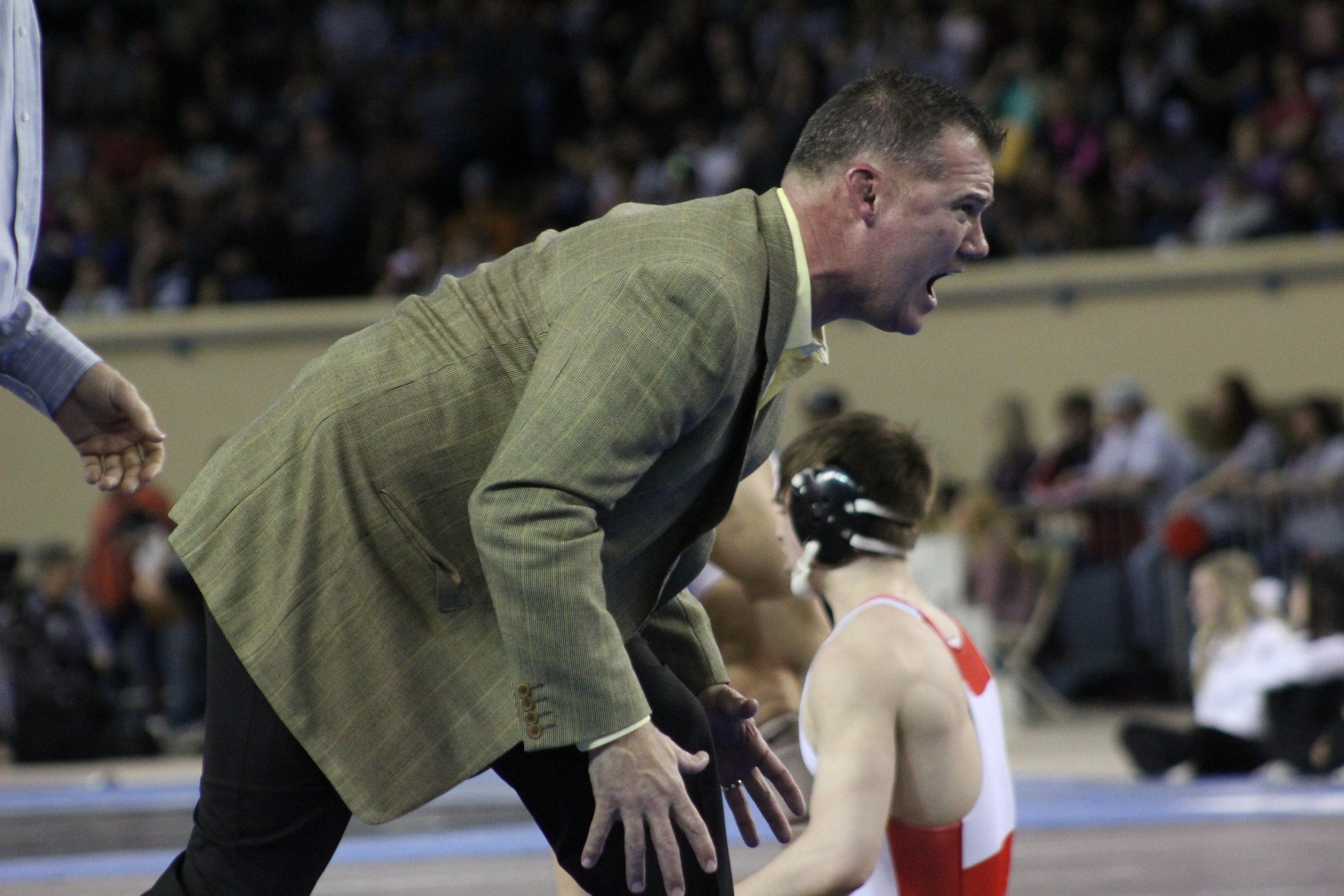 Assistant coach Derek Fix gets heated while coaching Beau Bratcher.