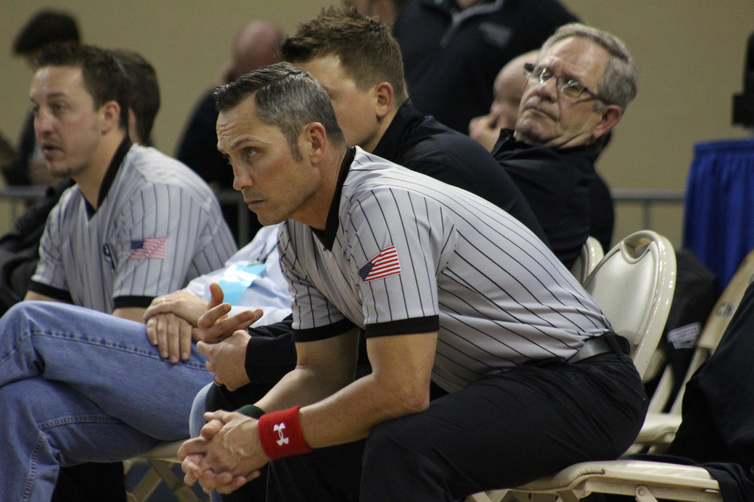Sand Springs alumnus and referee Josh Briscoe eagerly watches Payton Scott's finals match.
