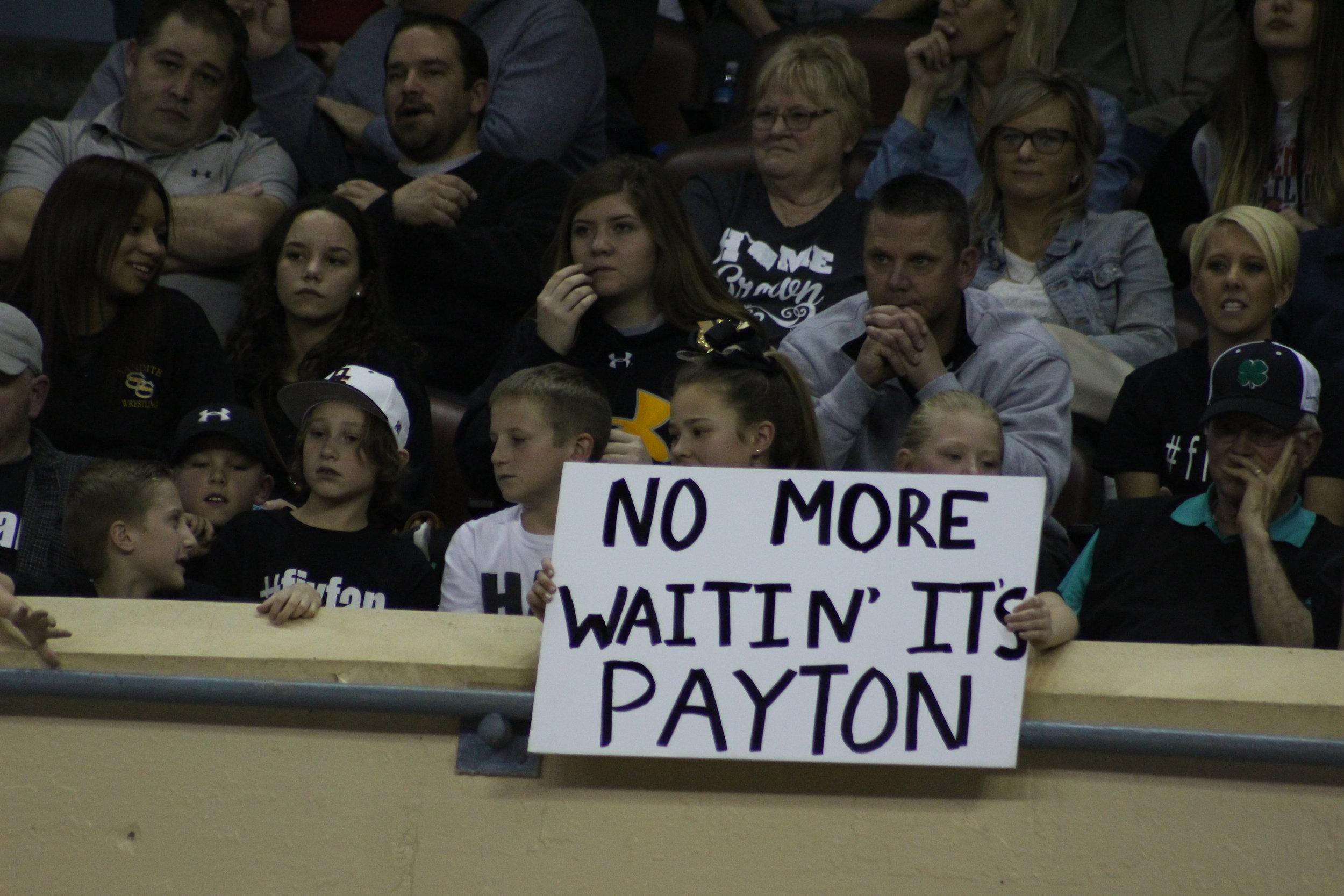 Sand Springs Wrestling fans cheer on Payton Scott.