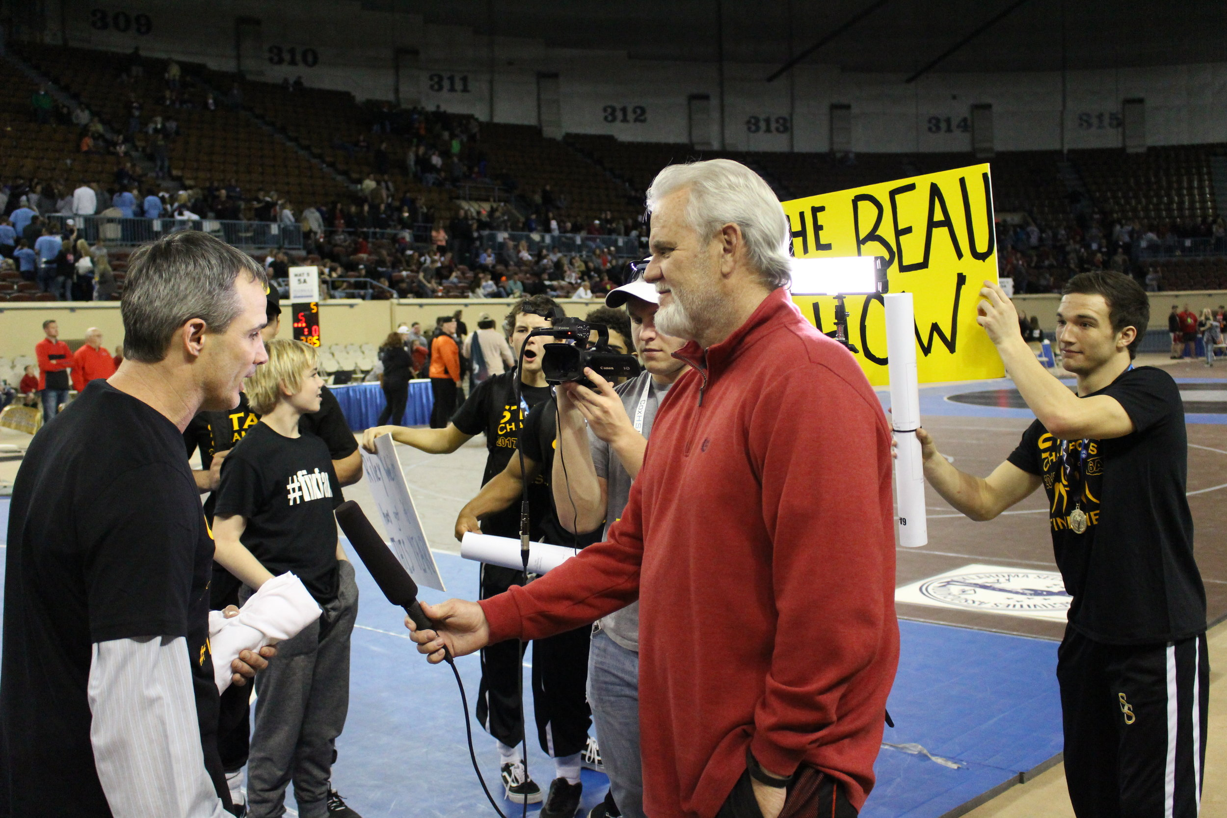 """Head Coach Kelly Smith gives a post-tournament interview, Beau Bratcher tries to get him to mention """"The Beau Show."""""""