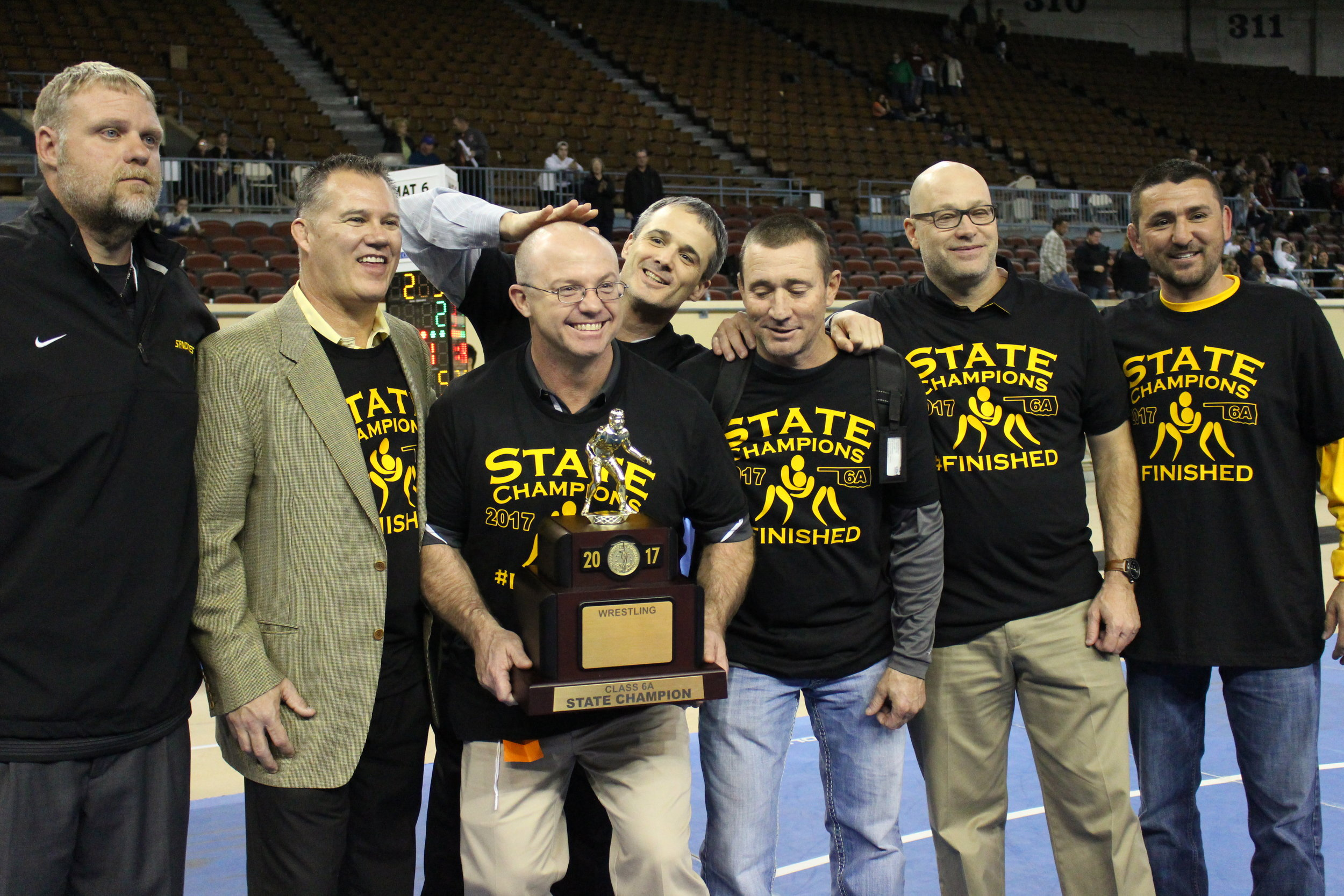 The 2016-2017 Sand Springs Wrestling coaching staff.