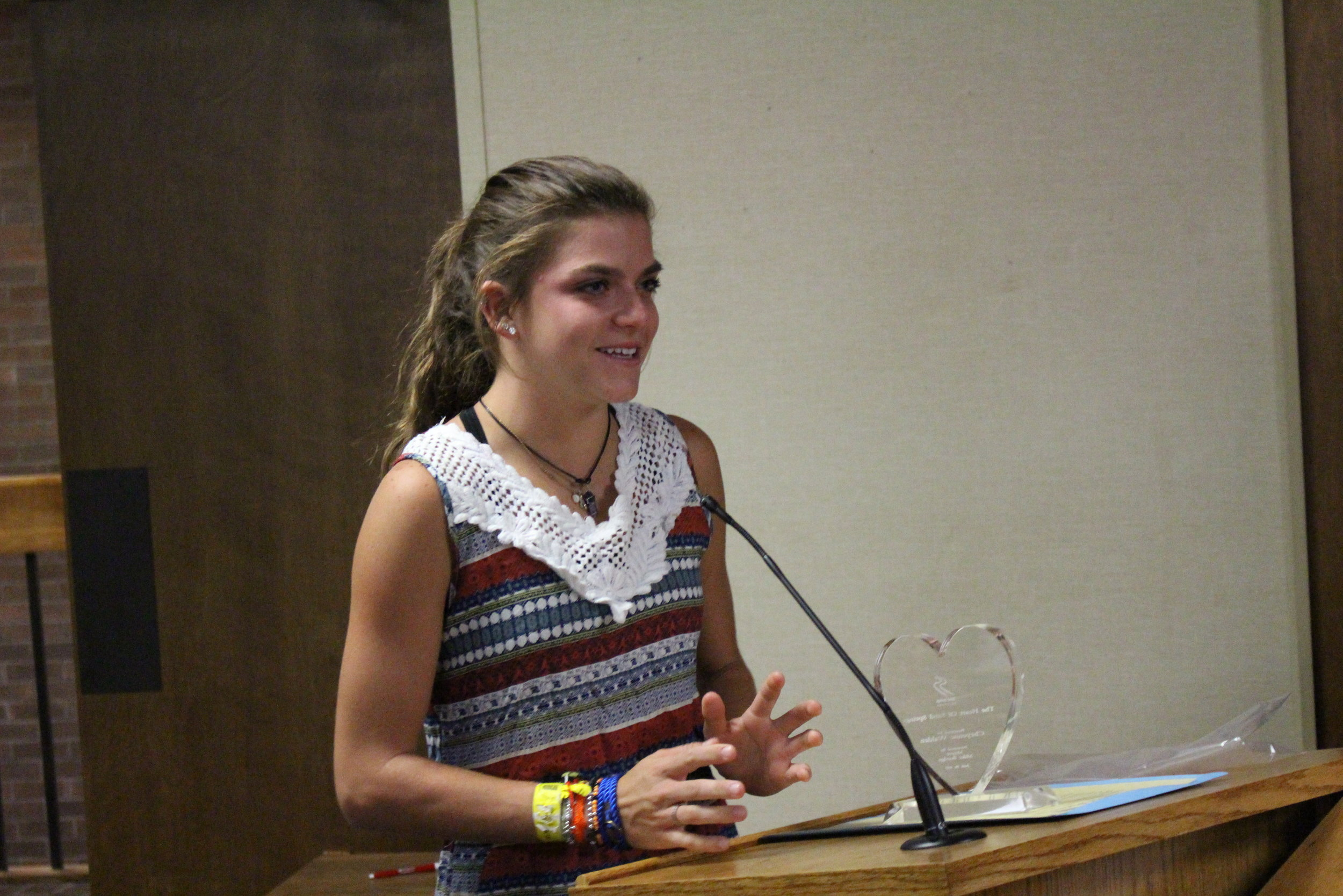 "Nine-time State Champion Cheyenne Walden receives the ""Heart of the City"" award at Monday night's City Council Meeting."