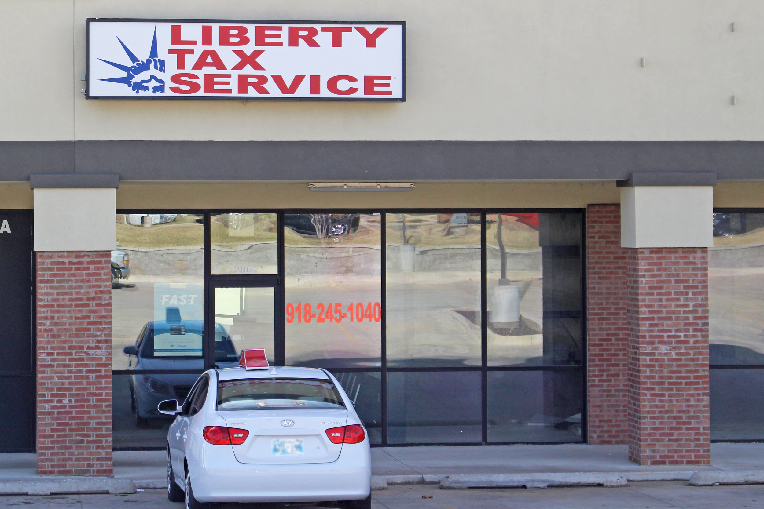 liberty tax service 302 west 2nd street, suite 200