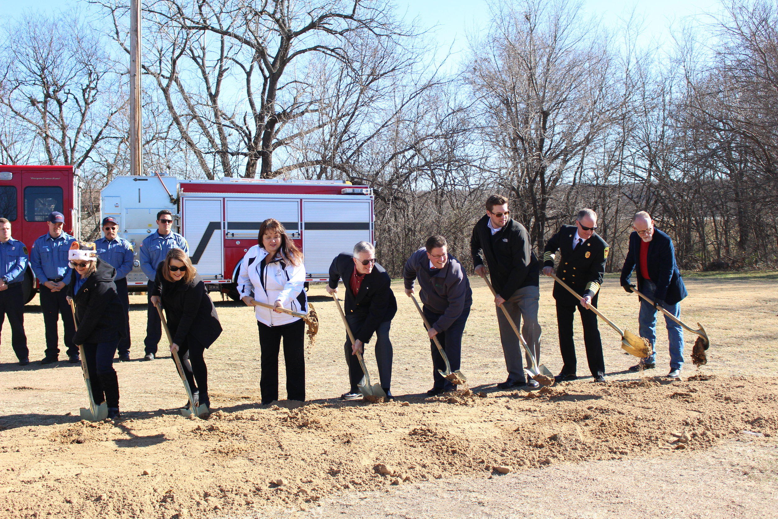 Members of the Sand Springs City Council, City Manager Elizabeth Gray, and Fire Chief Mike Wood turn dirt at the Fire Station No. 2 Ground-Breaking Ceremony.