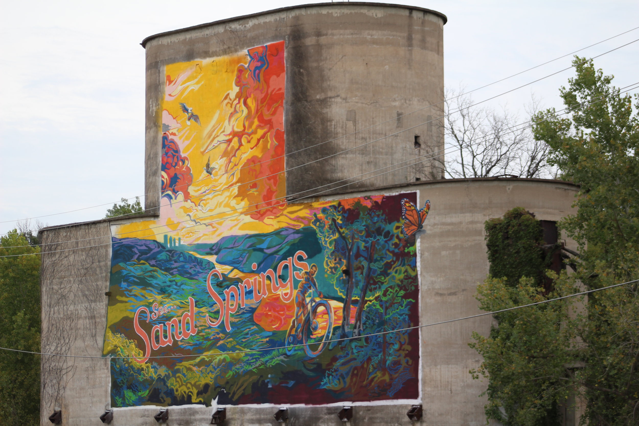 A half-minished mural by artist Josh Butts on the abandoned Monarch Cement Silo. 170928 (Scott Emigh).JPG