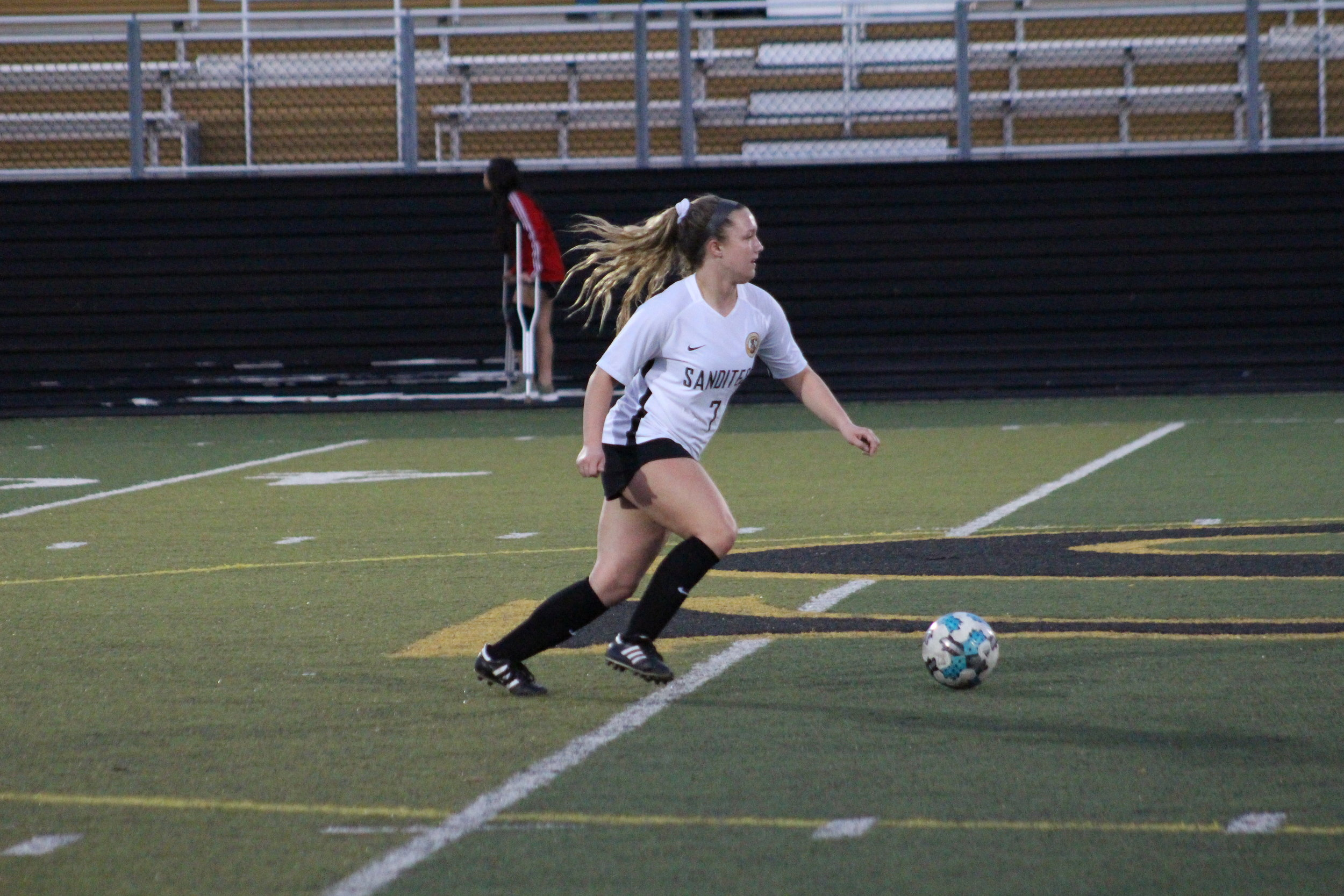 Kylie Taylor scored the first goal of the season for the Sand Springs Lady Sandites. (Photo: Scott Emigh).