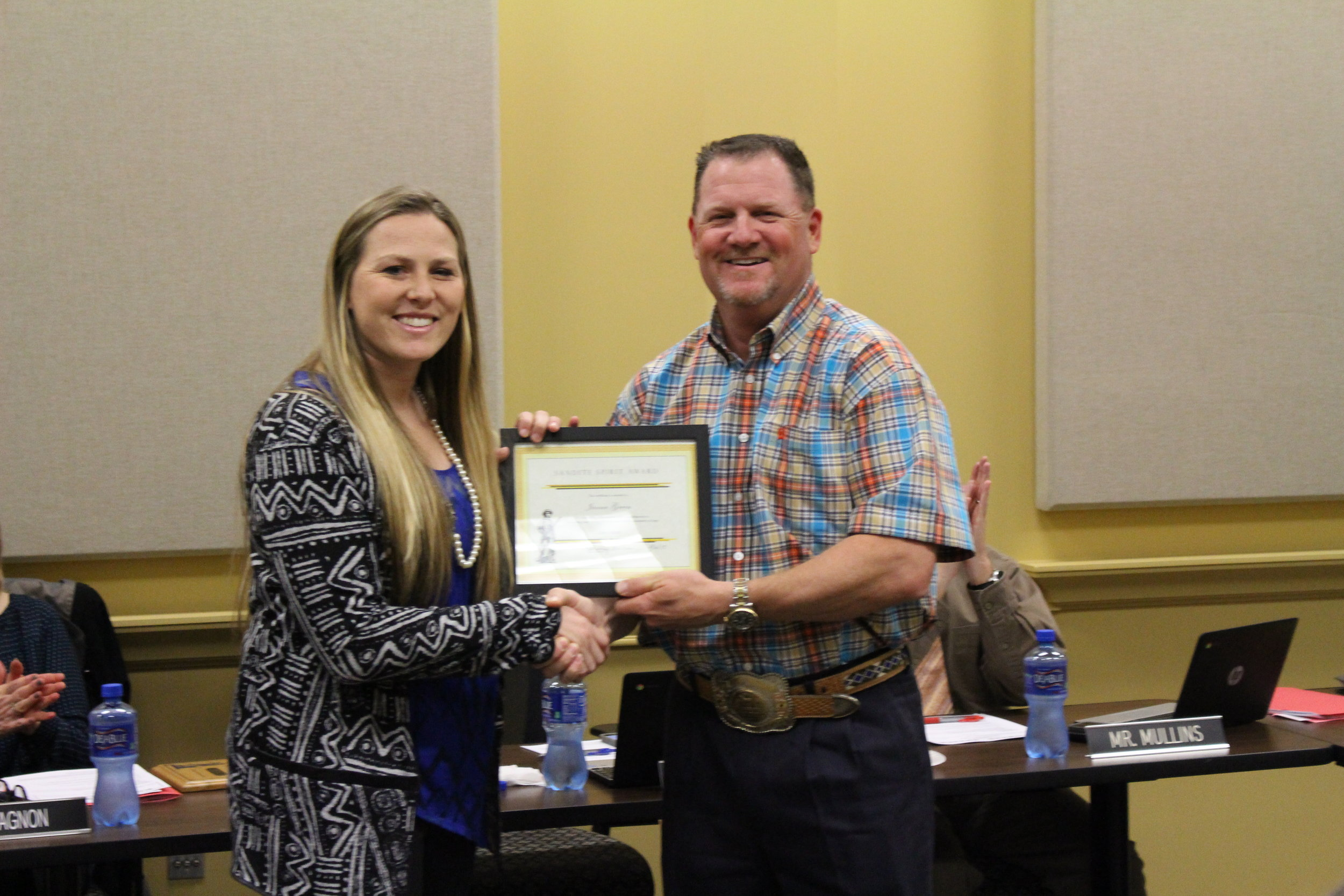 Feb. 06, 2017. SSPS Board of Ed member Bo Naugle presents CPHS Volleyball Coach Janna Green with the Sandite Spirit Award. (Photo: Scott Emigh).