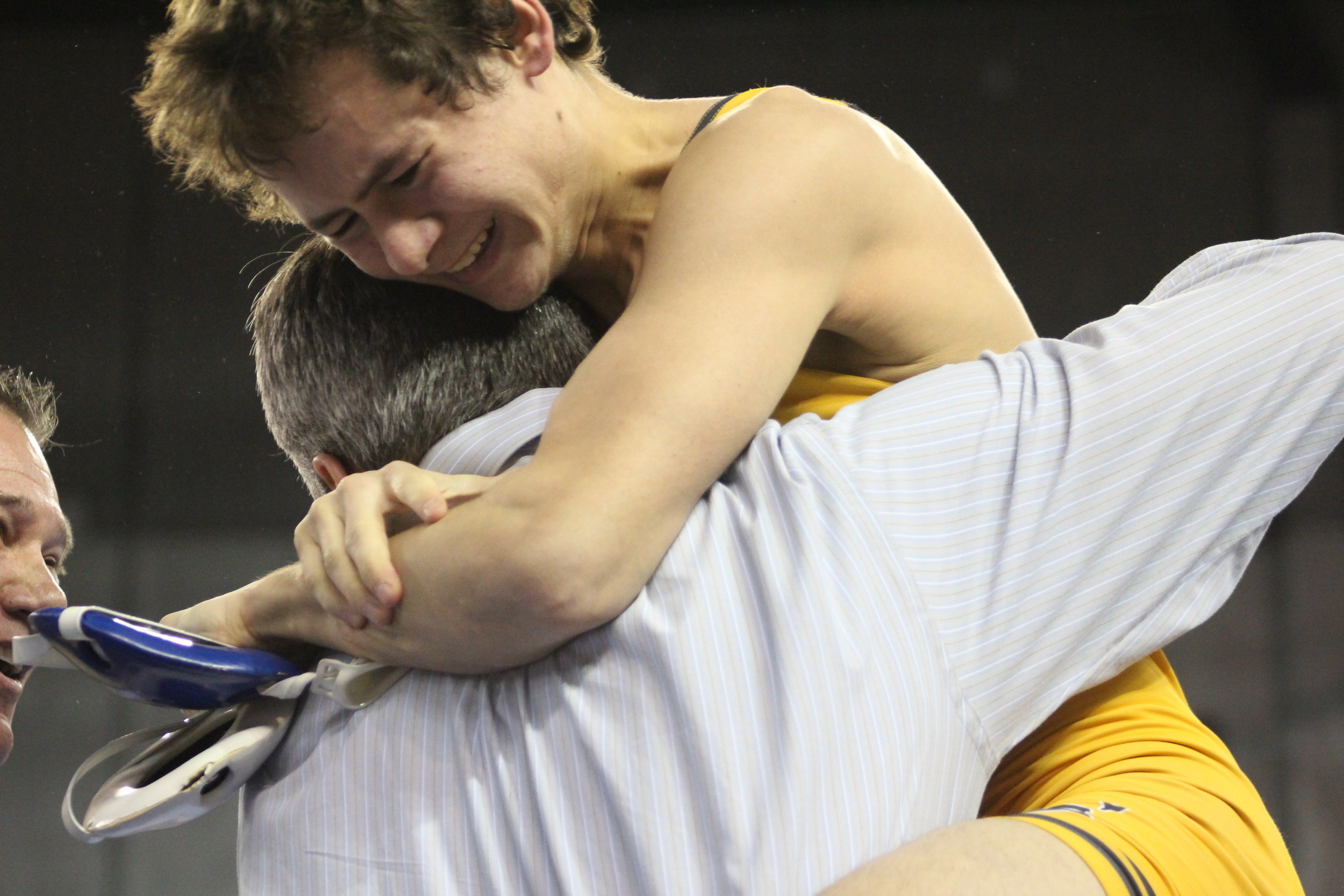 Riley Weir hugs CPHS Head Wrestling Coach Kelly Smith after winning the 2017 State Championship. (Photo: Scott Emigh).