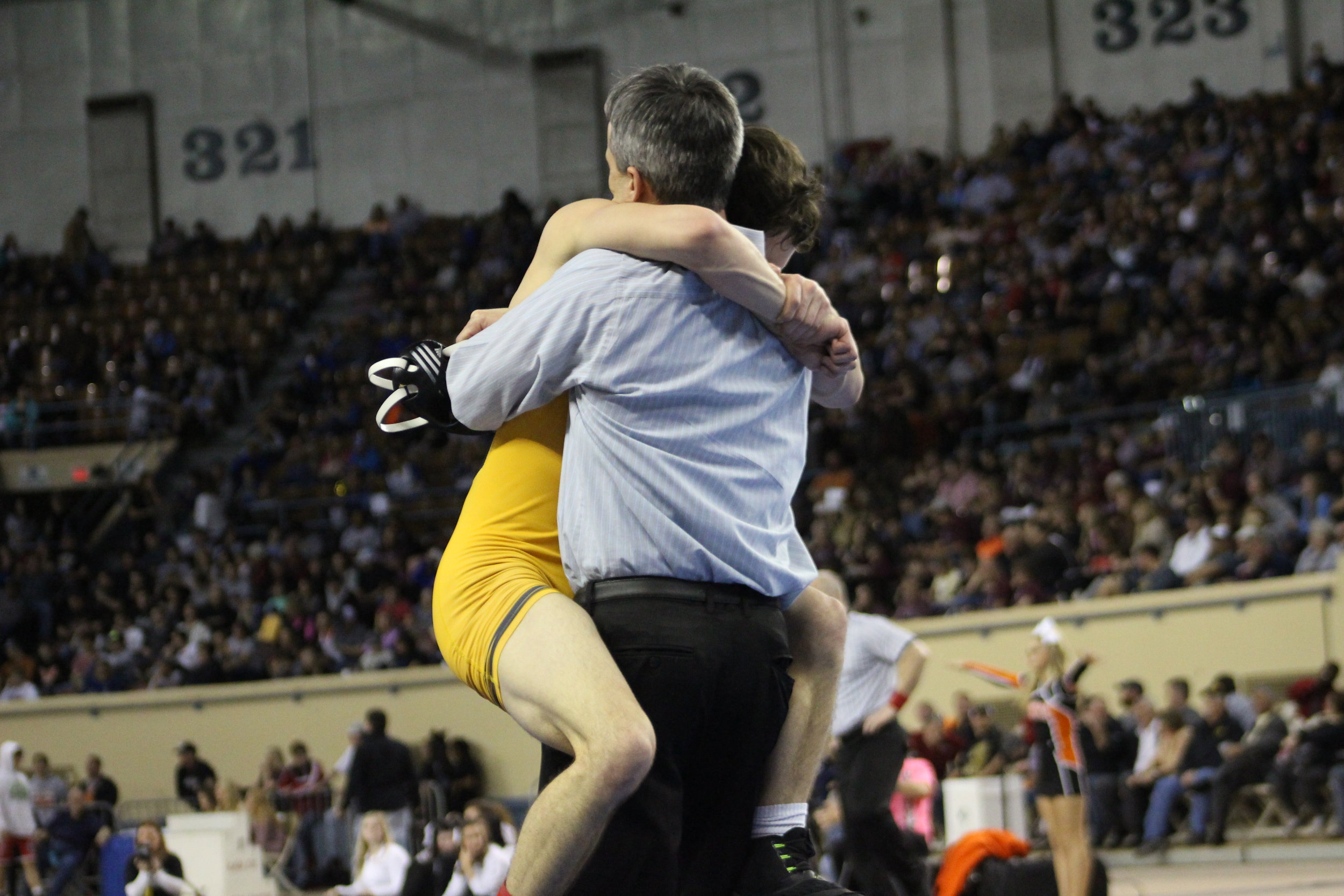 Beau Bratcher hugs his uncle, CPHS Head Wrestling Coach Kelly Smith, after winning the 2017 State Championship. (Photo: Scott Emigh).