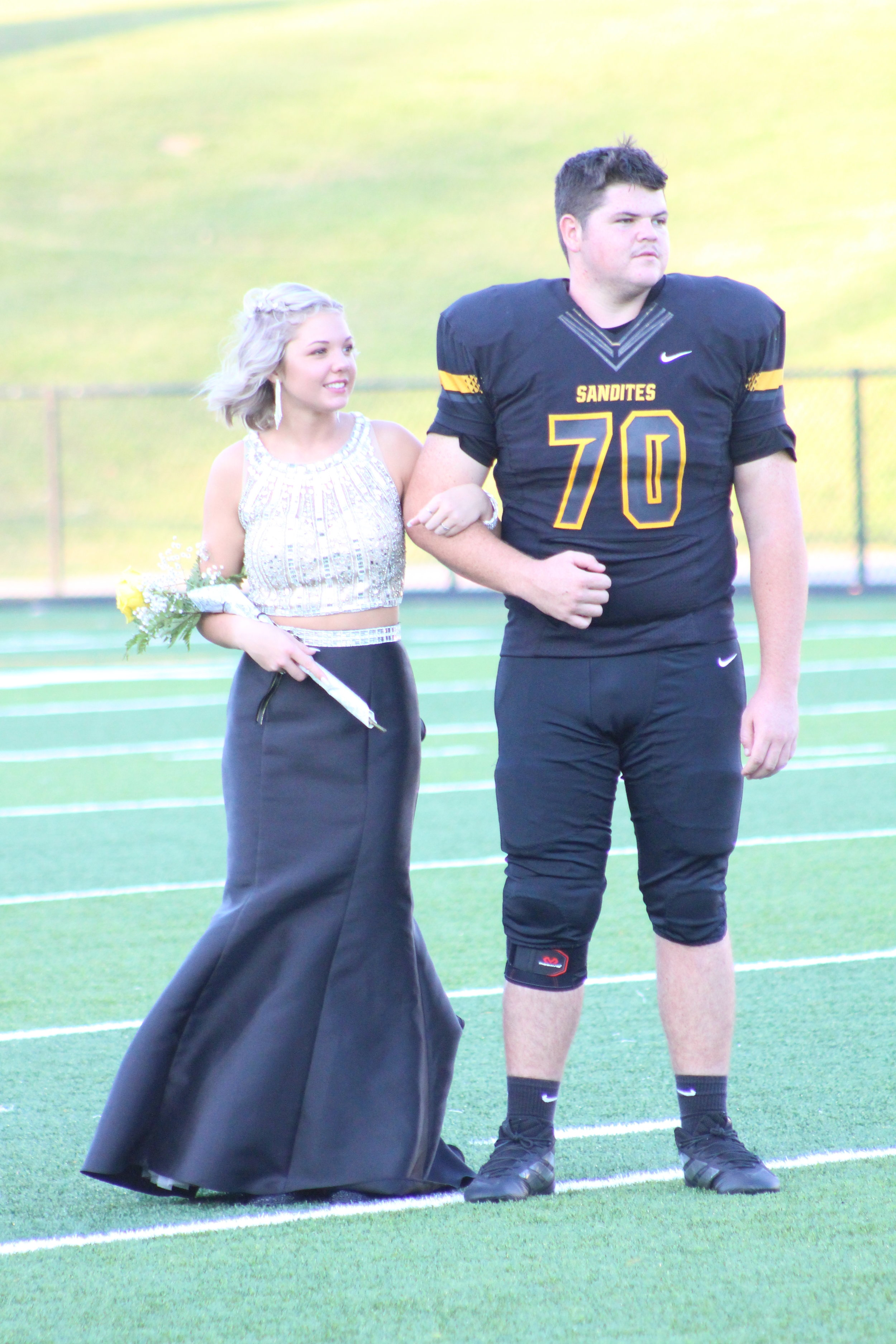 Kendal Pearson, escorted by Nicolas Hancock. Pearson is the daughter of Tim and Keri Pearson and is a three-year varsity Dance Team member. Hancock is the son of Danny and Jennifer Hancock and is a three-year varsity offensive lineman.