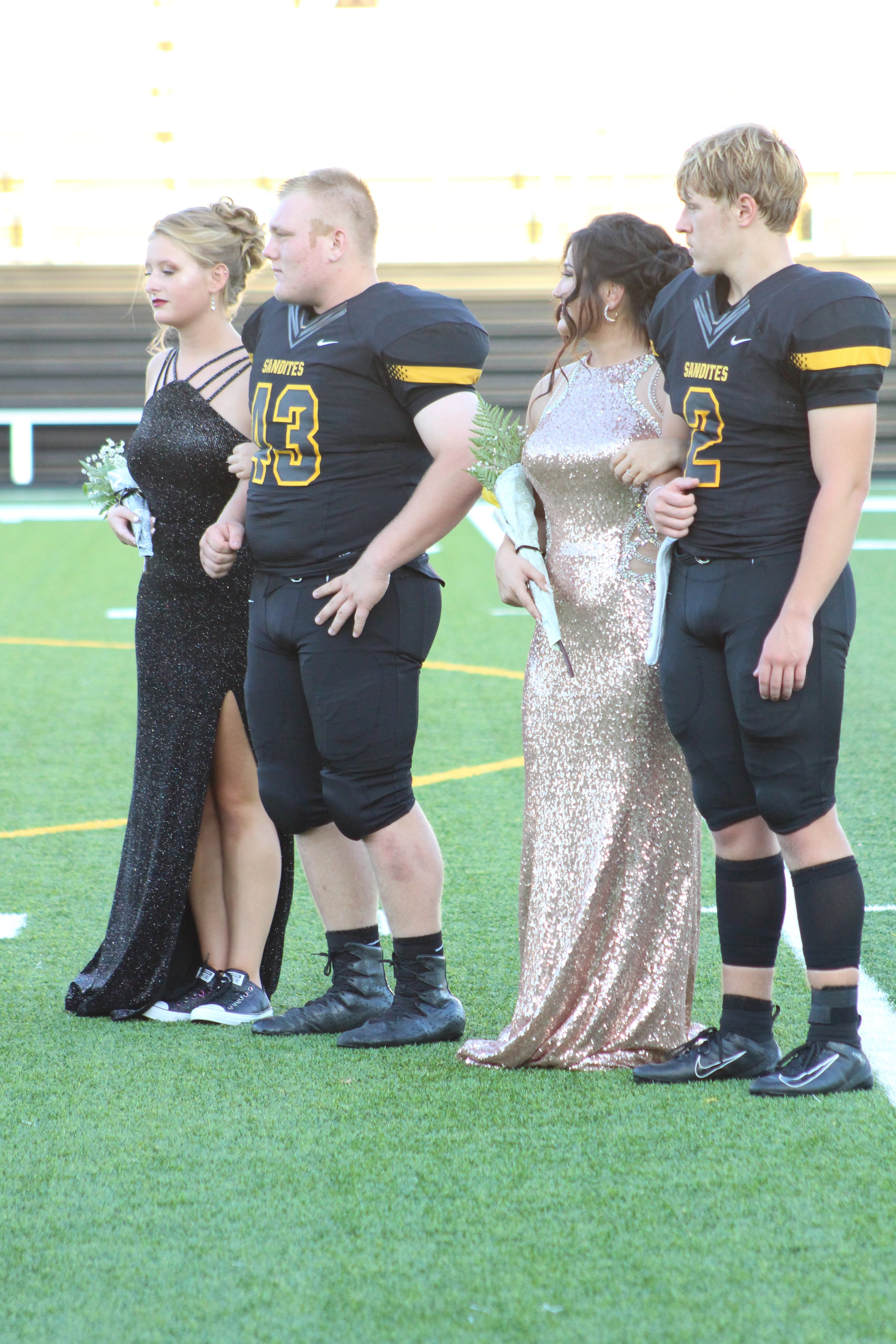 Haley Stuckey (left), escorted by Ethan Sartin. Stuckey is the daughter of Erik and Kerri Stuckey and is a four-year member of the Gold Pride Marching Band. Sartin is the son of Michael and Jennifer Sartin. This is his first year as a varsity linebacker.  Tatum Denton (right), escorted by Justin Roe. Denton is the daughter of Brad and Angela Denton. She is a three-year varsity dancer. Roe is the son of David and Dianna Roe. He is a three-year varsity wide receiver and defensive back.